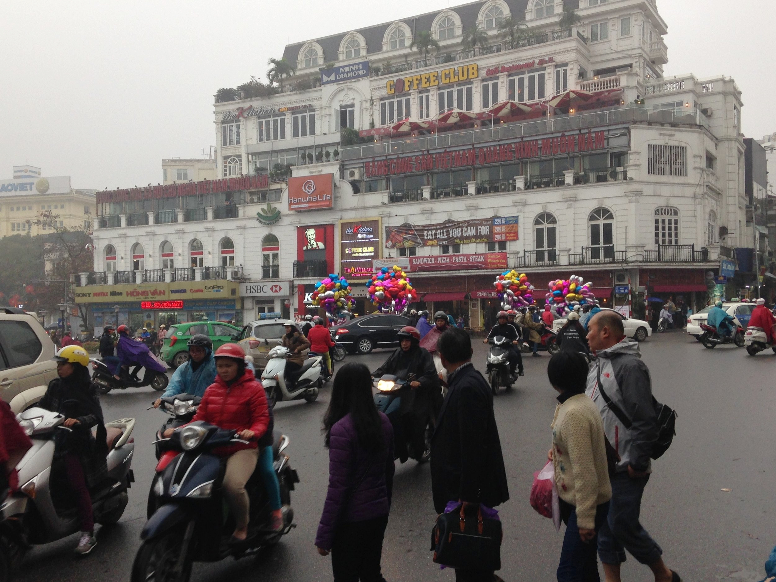 Teeming Hanoi. The only way to cross the road is to walk out into the traffic.....and keep walking!