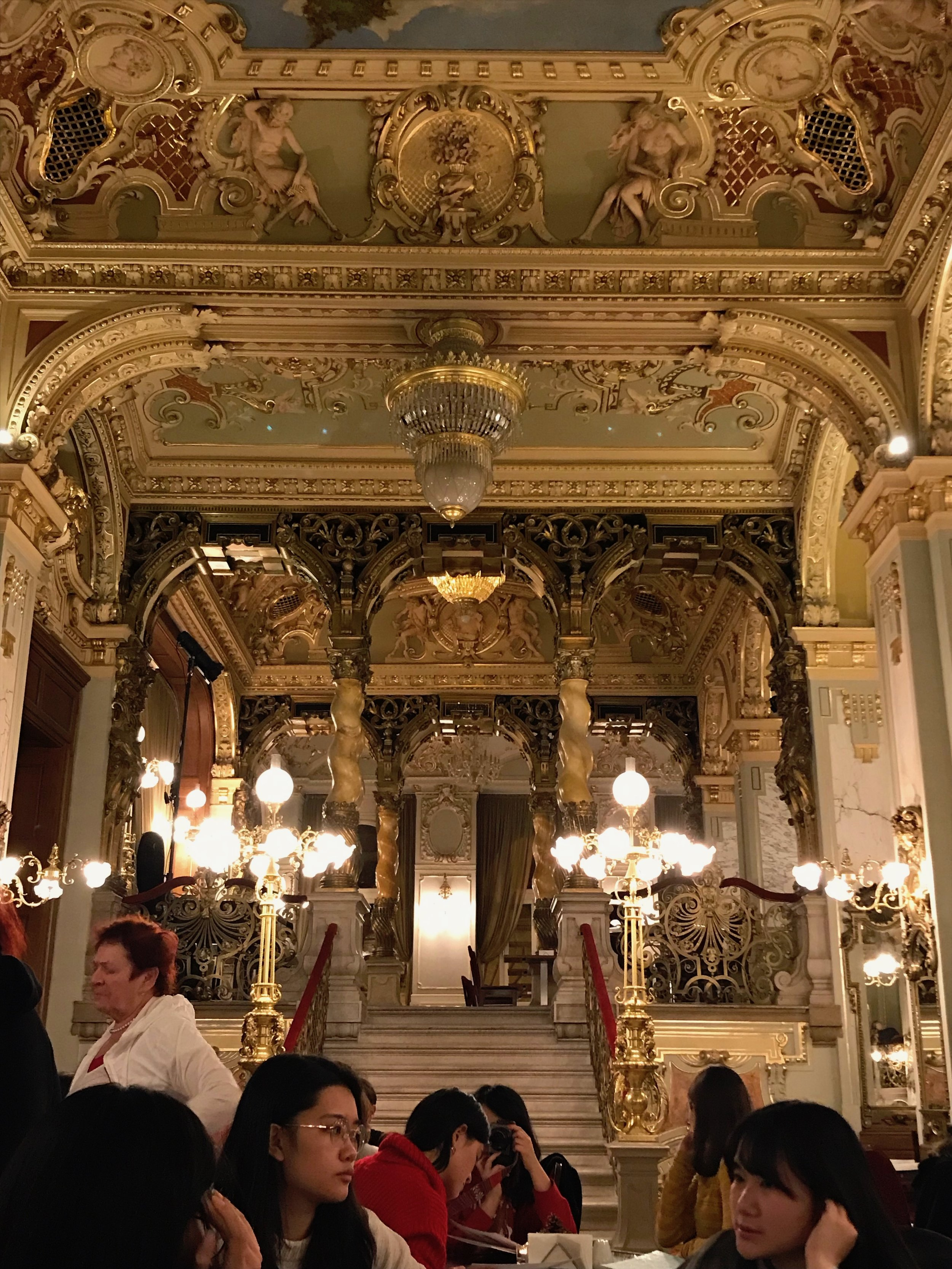 The gloriously ornate interior of the New York Cafe