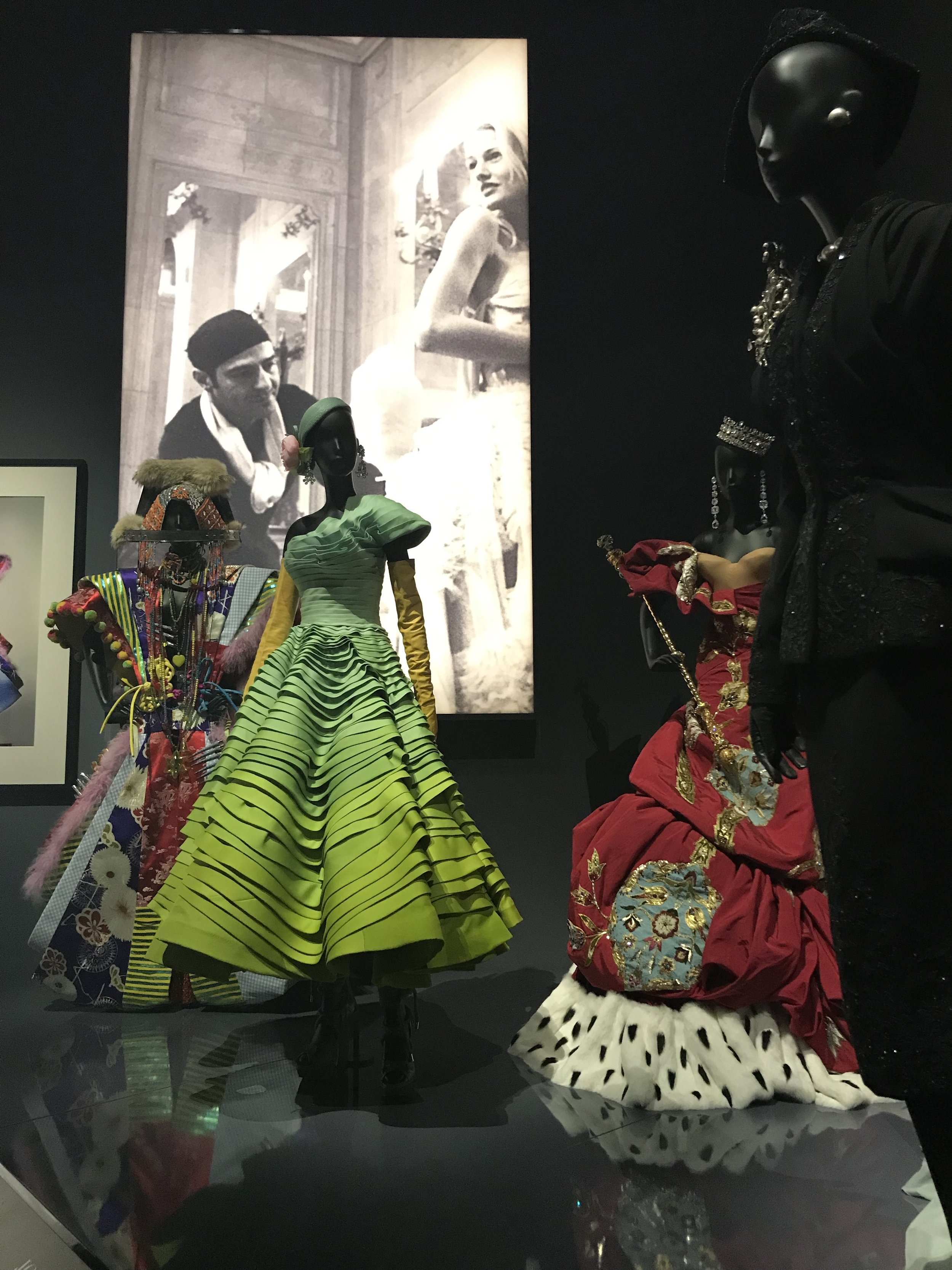 A shot of John Galliano provides the backdrop for some of his Dior designs