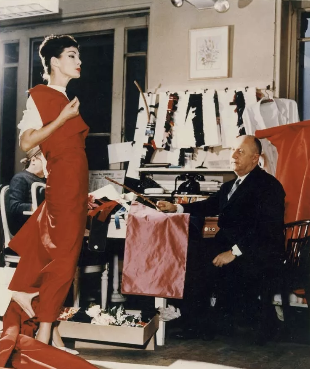 Christian Dior at work on one of his creations