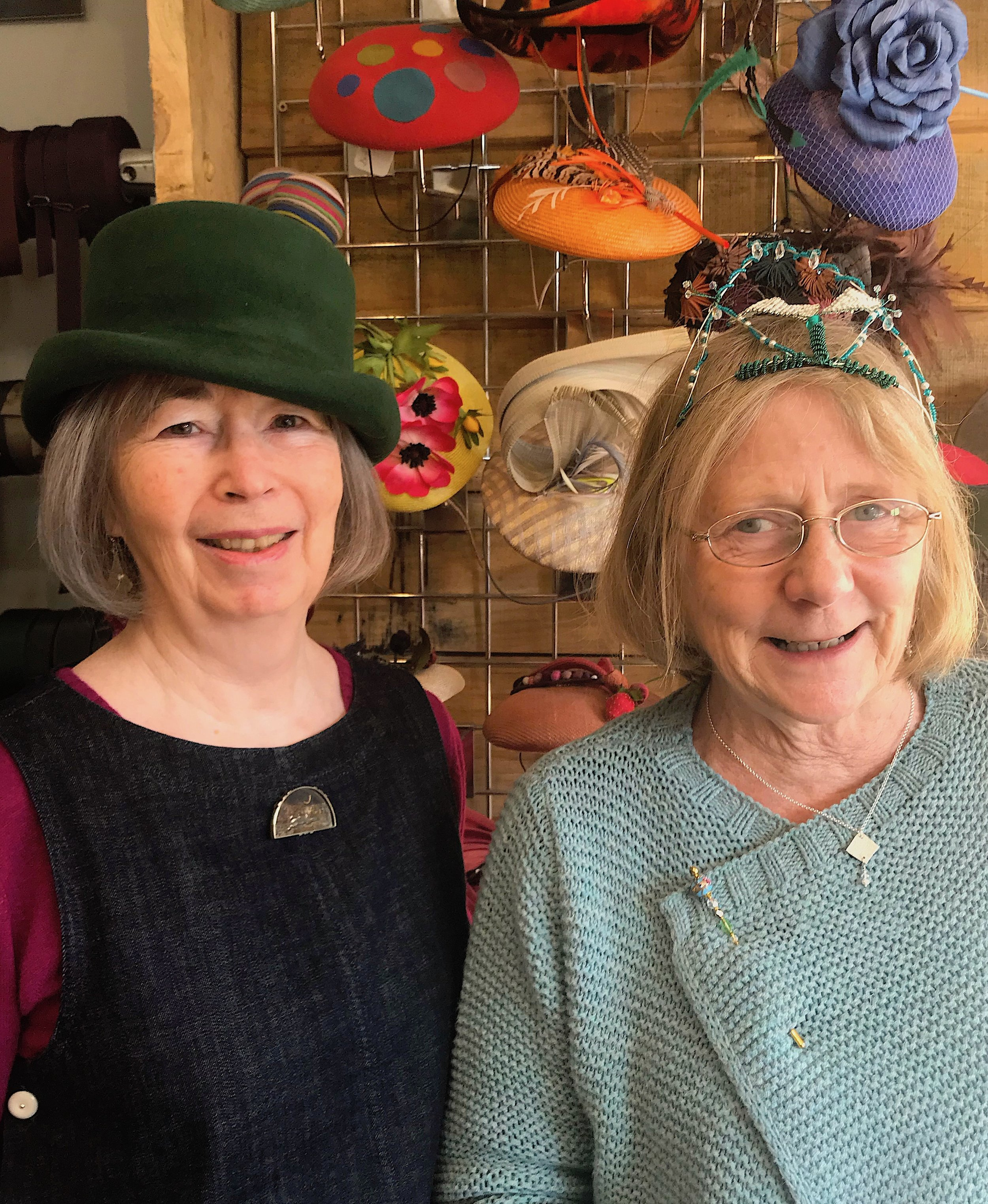 Lynn modelling one of her felt hats, and Verna wearing one of her beaded creations