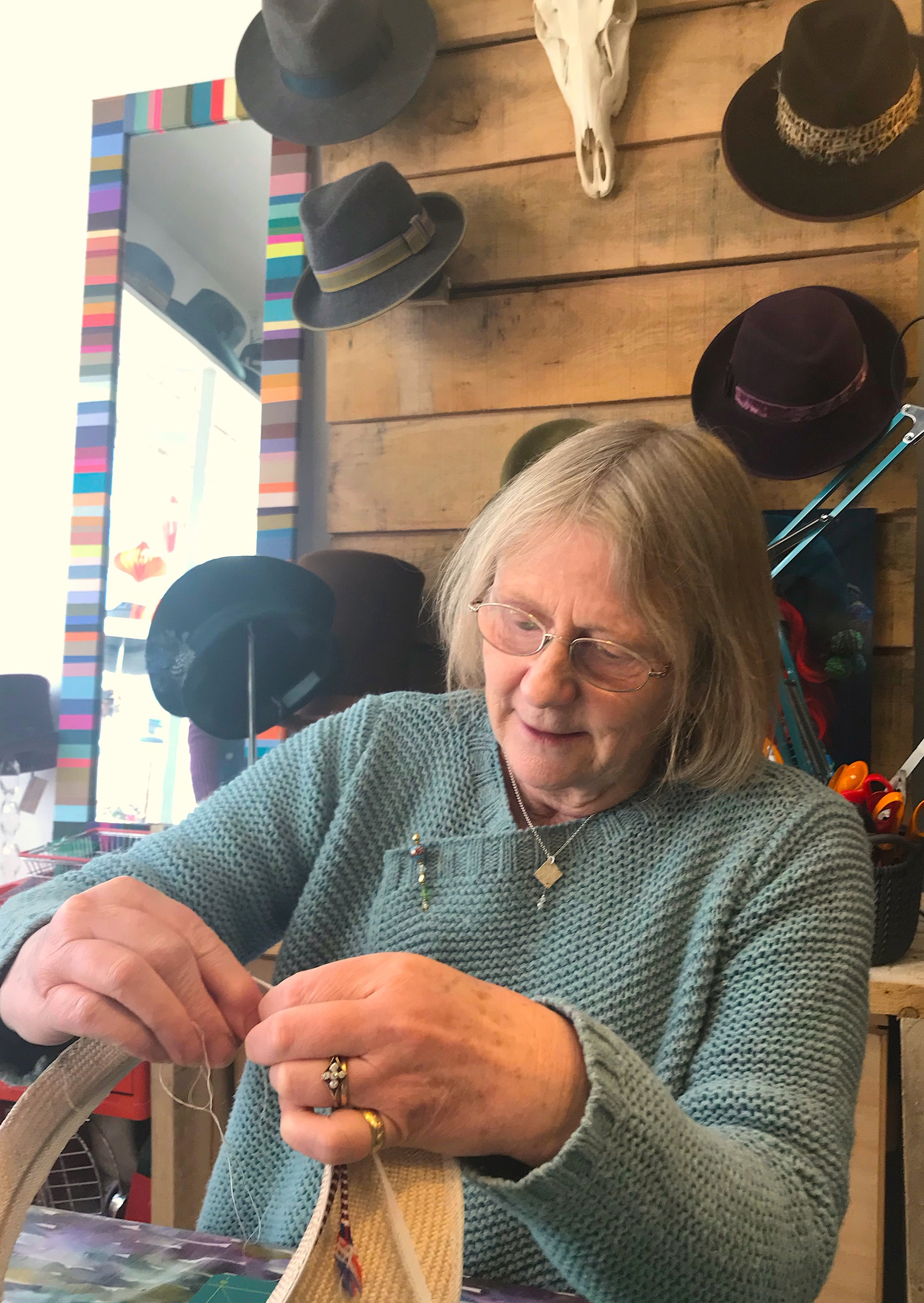 Vera at work on the brim of a straw hat