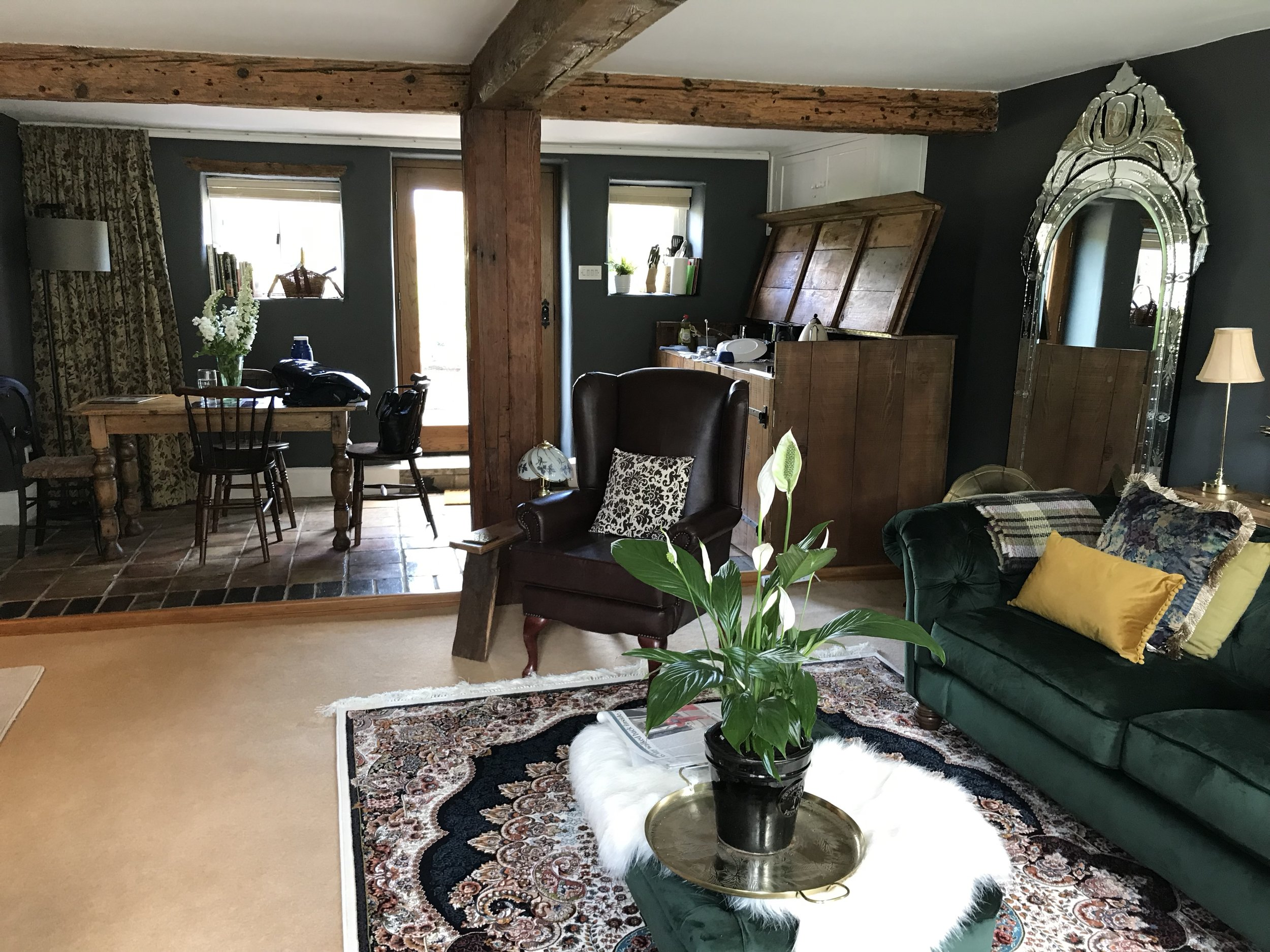 The open-plan living, dining and kitchen room in our beautifully decorated and furnished 16th century Airbnb