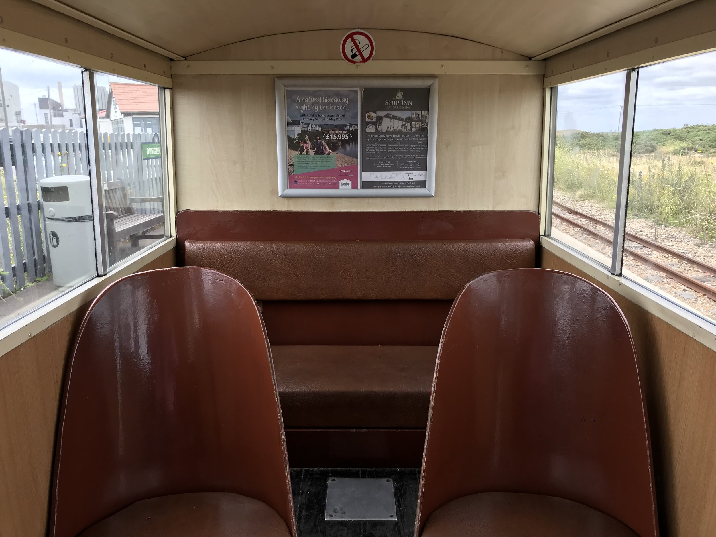 The carriages on the one-third size steam trains are just two seats wide.