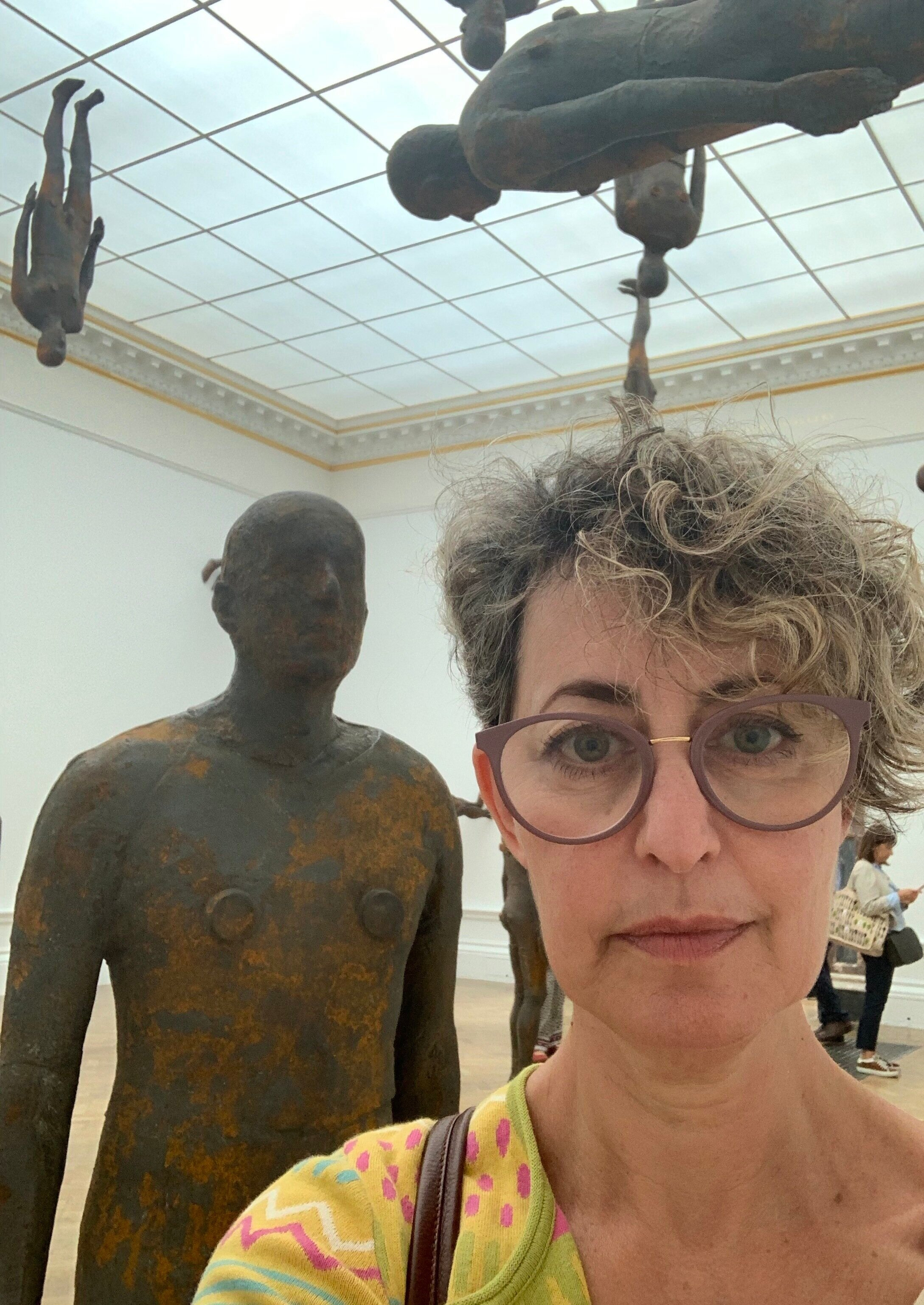 Anthony Gormley's signature body cast sculptures apparently defying gravity in his new Royal Academy show
