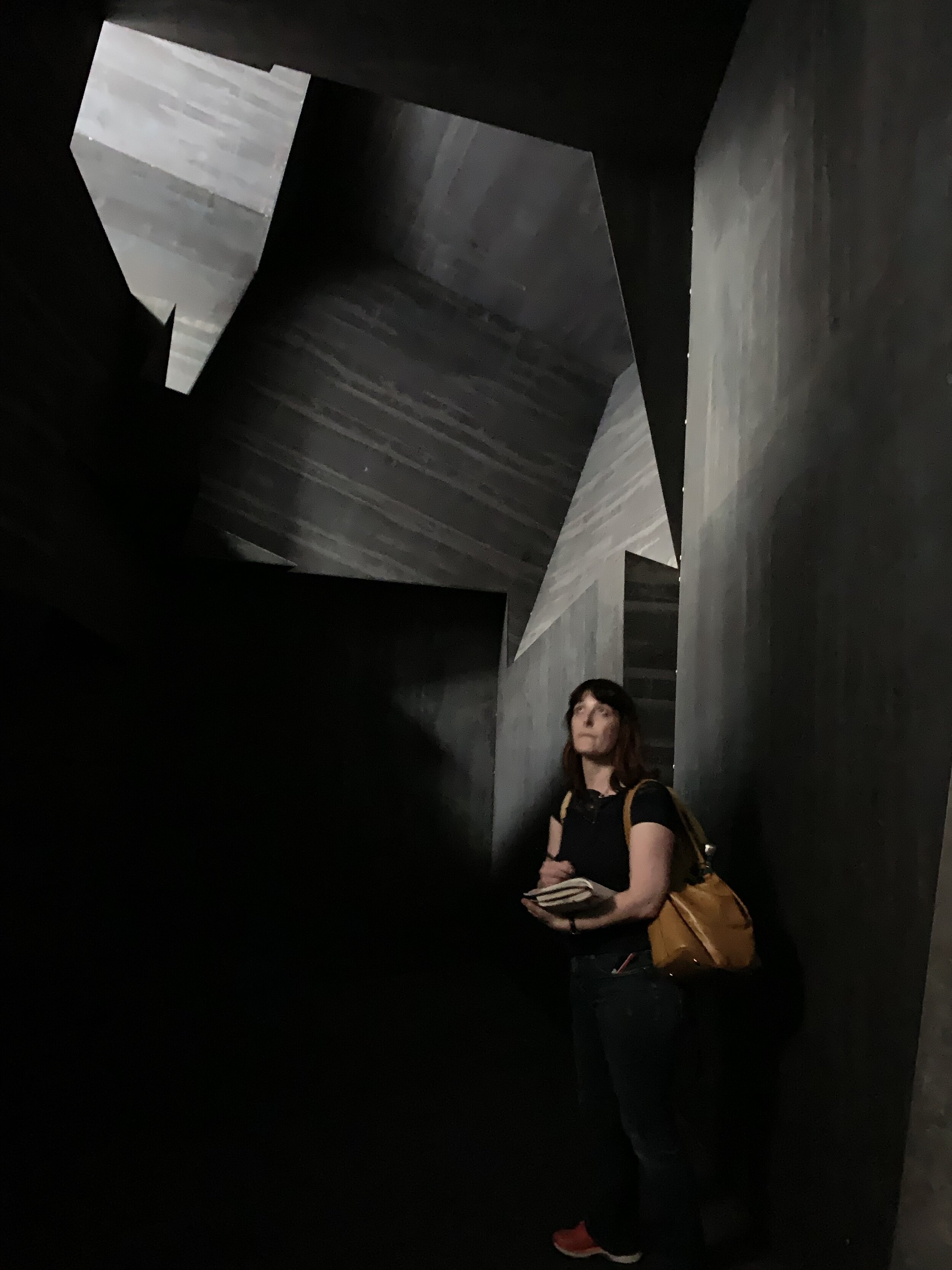 This is what it looks like in the hollow interior (the woman in the picture was drawing the magical interplay of light and shadow on the beautiful geometric sections of the sculpture)