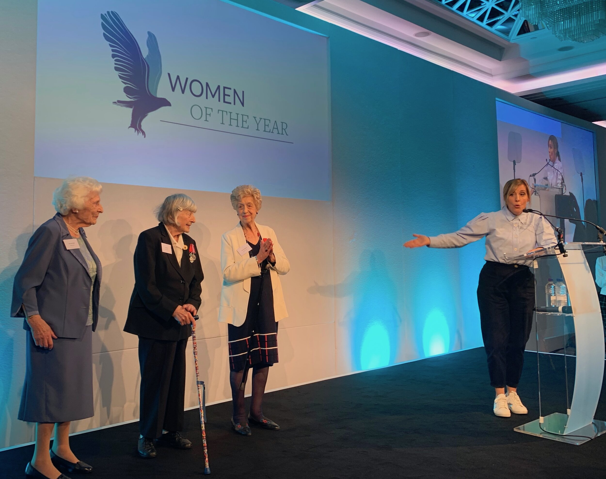 Ruth (far right) and her code-breaking colleagues, Pat (centre) and Betty (left) being introduced to the Women of the Year attendees (who were giving them a deafening standing ovation) by host Mel Giedroyc