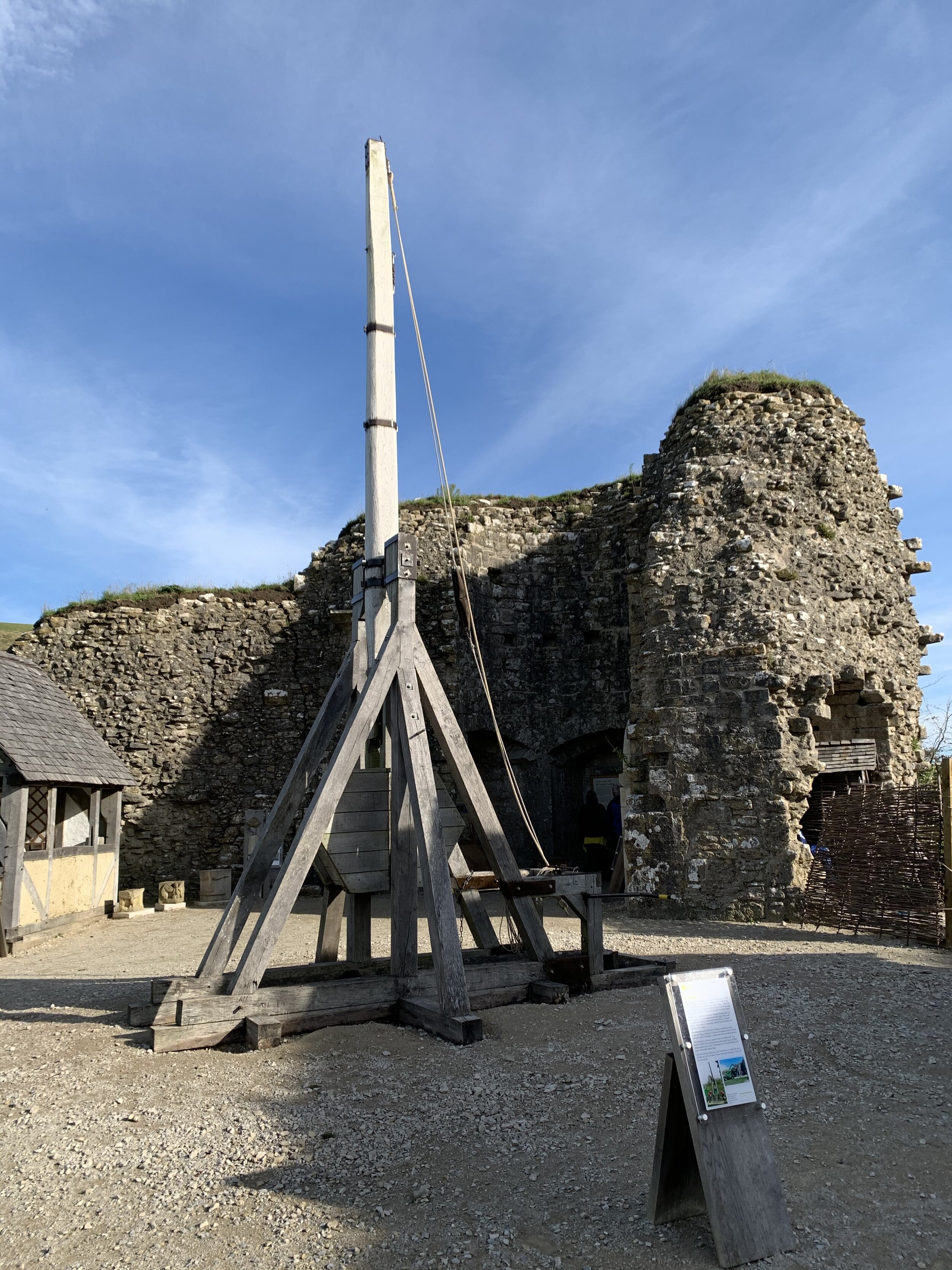 This trebuchant is a medieval version of a catapult. The missile is placed in a chute at the bottom and then propelled out by the 'hammer' end of the pivoted arm