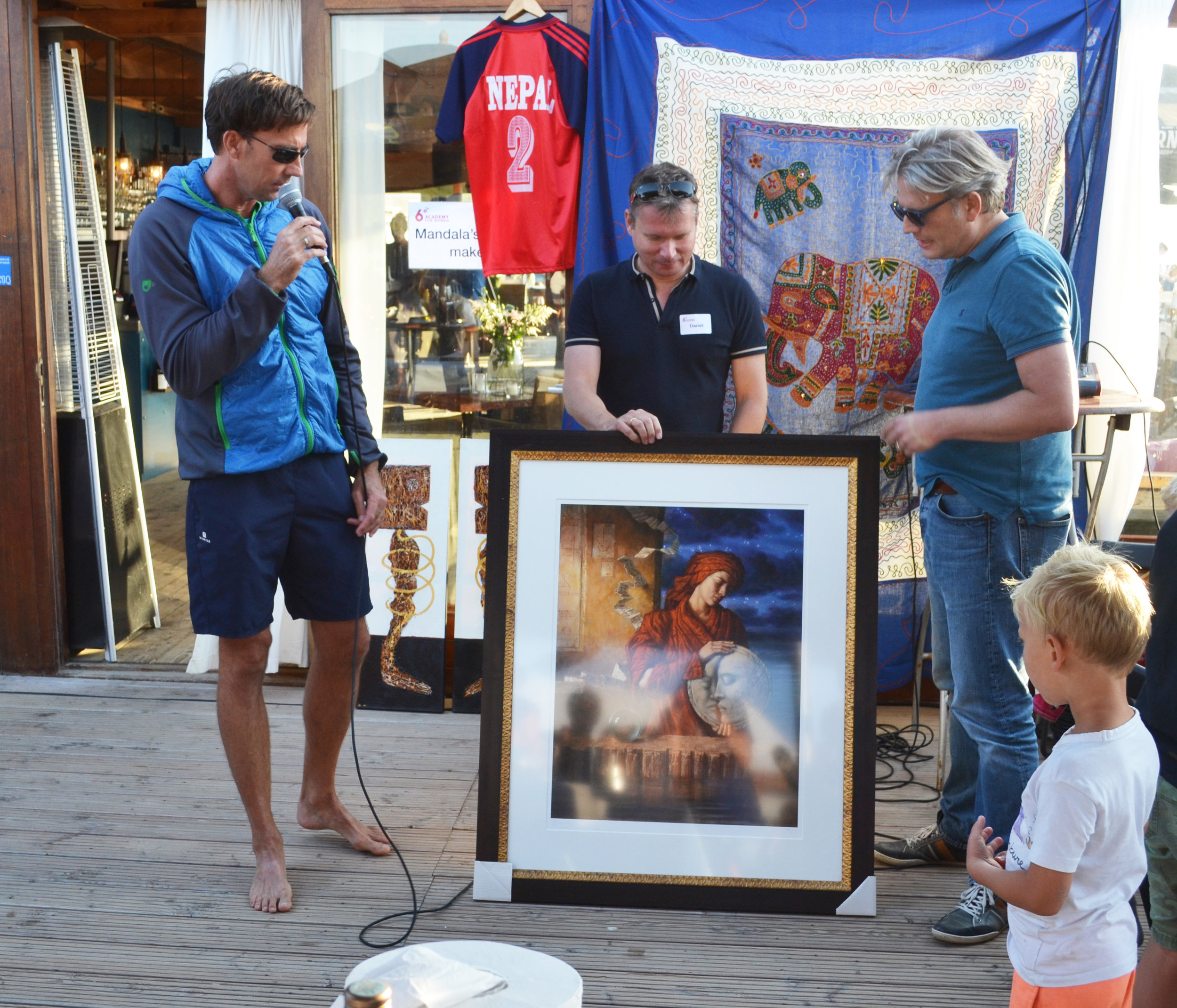 A painting to be auctioned being explained by our generous donor
