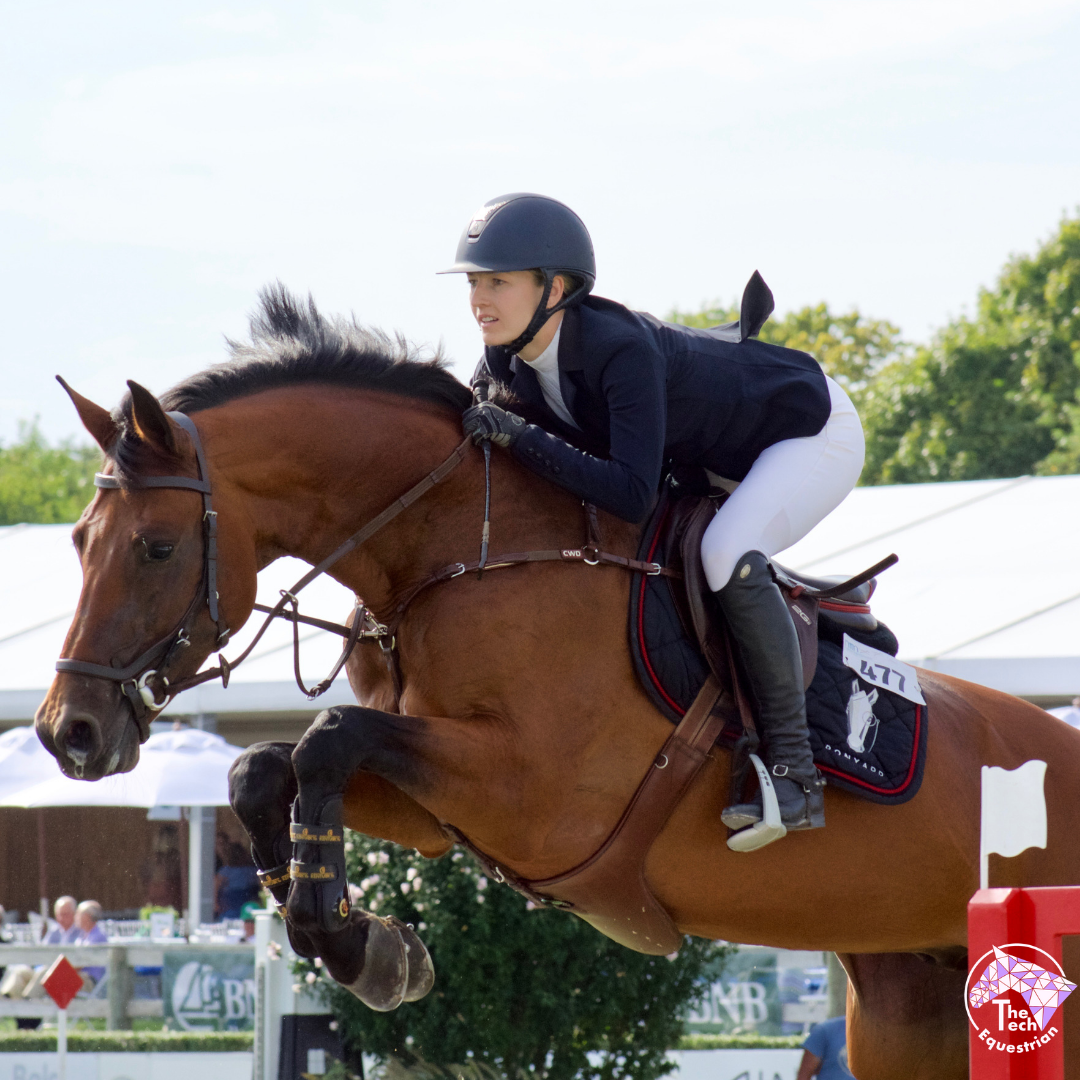 Lucy Davis and her 9-year-old gelding Caracho (Teddy) soar over an obstacle at the Hampton Classic