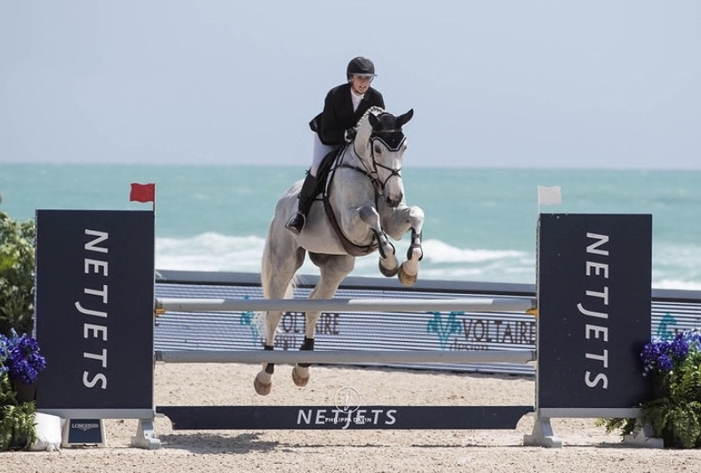 Misty riding Snoopy in the Miami Beach Longines Global Champions Tour this year.