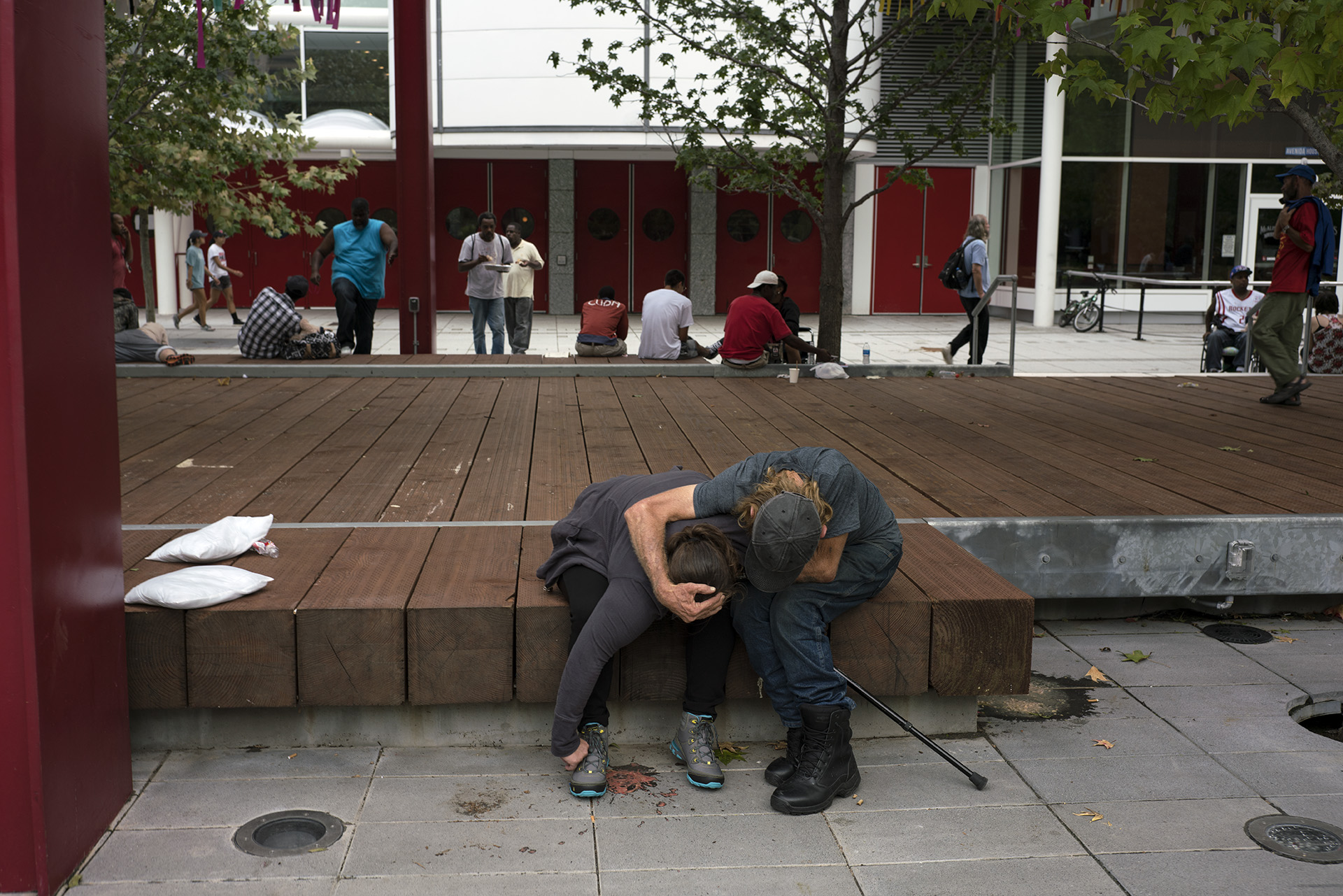 Evacuees outside of the convention center. Many addicts were outside the center coming down off of their addictions and had vomited on the sidewalks. When a disaster such as Harvey happens the underlying needs of society are laid bare and take an additional toll on how to respond to the many requirements that people have to survive.