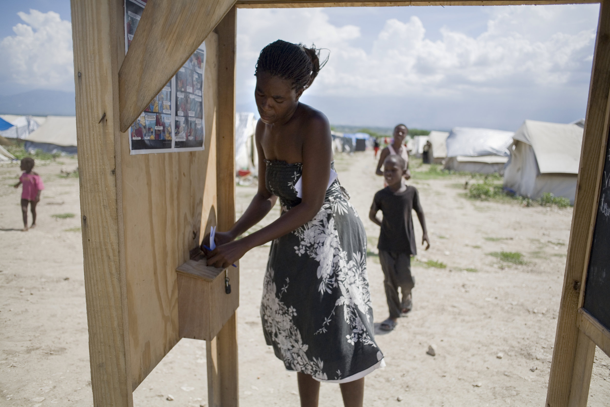 January 16, 2018   Haiti remembrance, day 4.  Of all the stories I produced in Haiti, this ranks up with the ones I'm most proud of. The focus of the story was Sandra Felicien, a smart and strong new mother who was concerned for her children and wanted to help make the camp she was relocated to, Corail-Cesselesse more livable. She was responding to a project initiated by the  #IOM  for people in the camps to write their feelings by posting letters in post boxes they set up throughout the country. The project managers themselves were skeptical that anyone would write, however thousands did, flooding the boxes with their hopes, thoughts, concerns and many needs. One of the Times' earliest exploration of multimedia you can also read some of her writing and hear her voice by visiting this link:   http://www.nytimes.com/20…/…/20/world/americas/20haiti.html