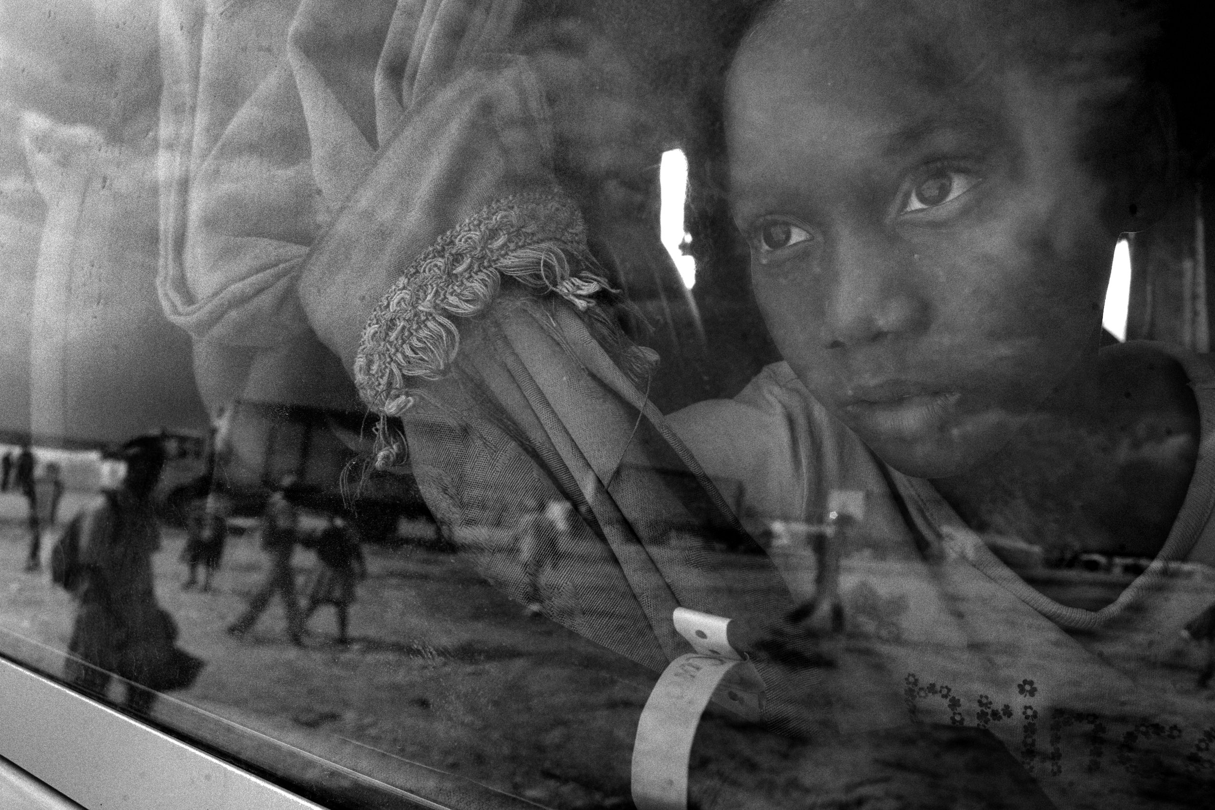 January 25, 2018   Haiti remembrance #7  I end this series of posts in the same place I began 7 pictures ago. This was the first moment a girl who was just arriving at the Corail-Cesselesse took in her austere surroundings in the camp that was shut off from so much of the rest of the nation. This place was supposed to be better, but it wasn't, an epic failure of the United Nations to secure better living conditions for those who were displaced in the earthquake. I wish I knew what she was thinking—regardless I found her beautiful and strong and deserving of better. When I opened the shutter for this picture I wish she had been arriving at a better place where she could realize a life and all of its possibilities and thus further contribute to all of our lives collectively making this world a better place. To that end, we do not need aid, perse, but an ability to recognize people's potential and invest in it. The returns will be worth it—@mcsquealien  I had intended for these photos to be 7 consecutive photos, but I'm glad that they turned out as they have, addressing the unfortunate comments of this American president at length and not letting go of the need to keep pushing back over time.  The conditions in Haiti are hard, but the people make it anything but a shithole. It seems like a lifetime ago that that disrespectful word was uttered. Since then there have been tremendous @womensmarch, a government shutdown, more incendiary comments by the president, and the #Dreamers and still holding on for the opportunity to keep #dreaming in this country. The momentum has to keep going, there's no other option.  On a personal note, my mom was also taken to the emergency room during this time. She's fine. It was an overreaction to a cold, but in her 80s you can't be too careful. A Haitian cab driver took us there and wasted no time in getting us to the emergency room. Needless to say I was thankful for his help and appreciate the fact that because of his efforts my mom got 