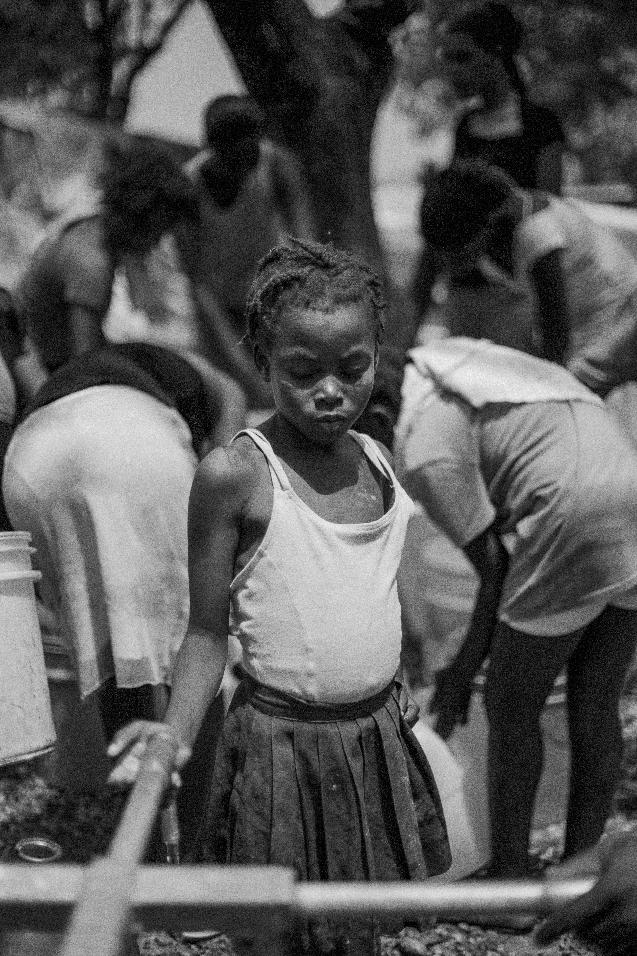 January 17, 2018   Haiti remembrance day 5  Since Monday I've been attending a fantastic fellowship at the Dart Center for  #Journalism  and Trauma at  #Columbia  University and we've been addressing apart form trauma healing as well, something so important for the ongoing needs in Haiti.  The photo of these two children has been on my mind quite a bit since I began posting this series of photos from Haiti. I took it in the Petionviille camp for the displaced. Although it had more resources than other camps, it was an incredibly difficult place to live with drinkable water scarce and rain water abundant that leaked through tents making it impossible to sleep and further inundated the camp creating a hard muddy existence.  The effect on children was severe. For much of the time when I looked at them I didn't see them as children but as people much older, battered and disillusioned by the hard life of living in an impoverished IDP camp. The picture of the girl following this photo waiting at a water pump exemplified that for me.  In the same camp, however was a remarkable yoga program run by an NGO which unfortunately I've forgotten the name of. I took an extensive series of portraits of the children feeling their breaths closing their eyes. Free of responsibility, pain and burden, they were children again. The yoga,  #meditation  and caring of the people who put this program together gave that back to them.  I think a lot can be learnt from this program of  #healing . In situations of such dire need it's understandable to perhaps perceive a yoga program as frivolous—it's anything but. It addresses essential mental health issues that far often go overlooked and targets issues that can cause debilitating  #PTSI   #PTSD  in the future.  Having documented the hardship that people go though I feel it's equally if not even more important to also identify programs and strategies that help people past their  #trauma , something that I will be devoting a lot more time to in t