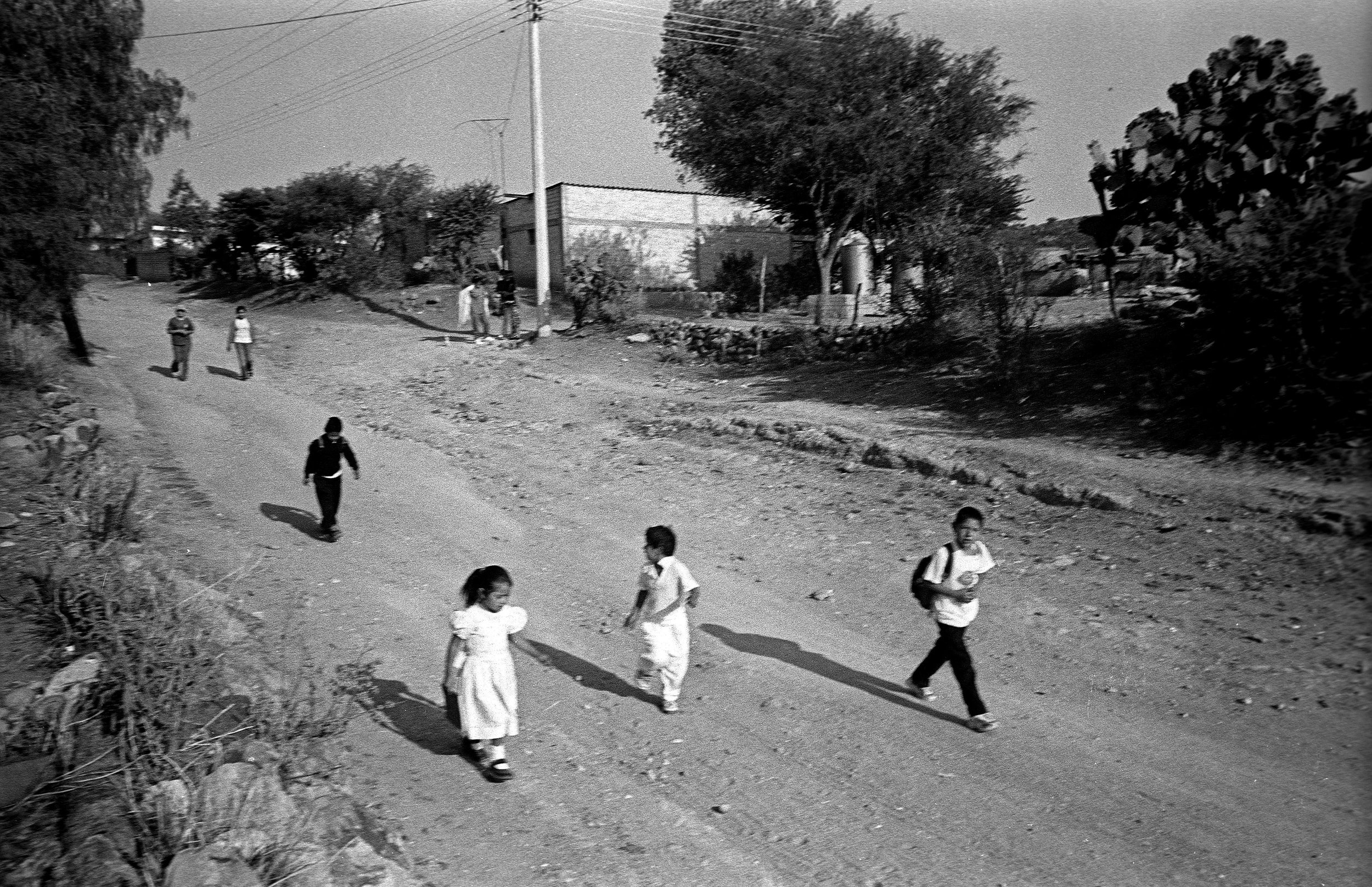 Young children walk to school. It's doubtful that any of these children still remain in the town.
