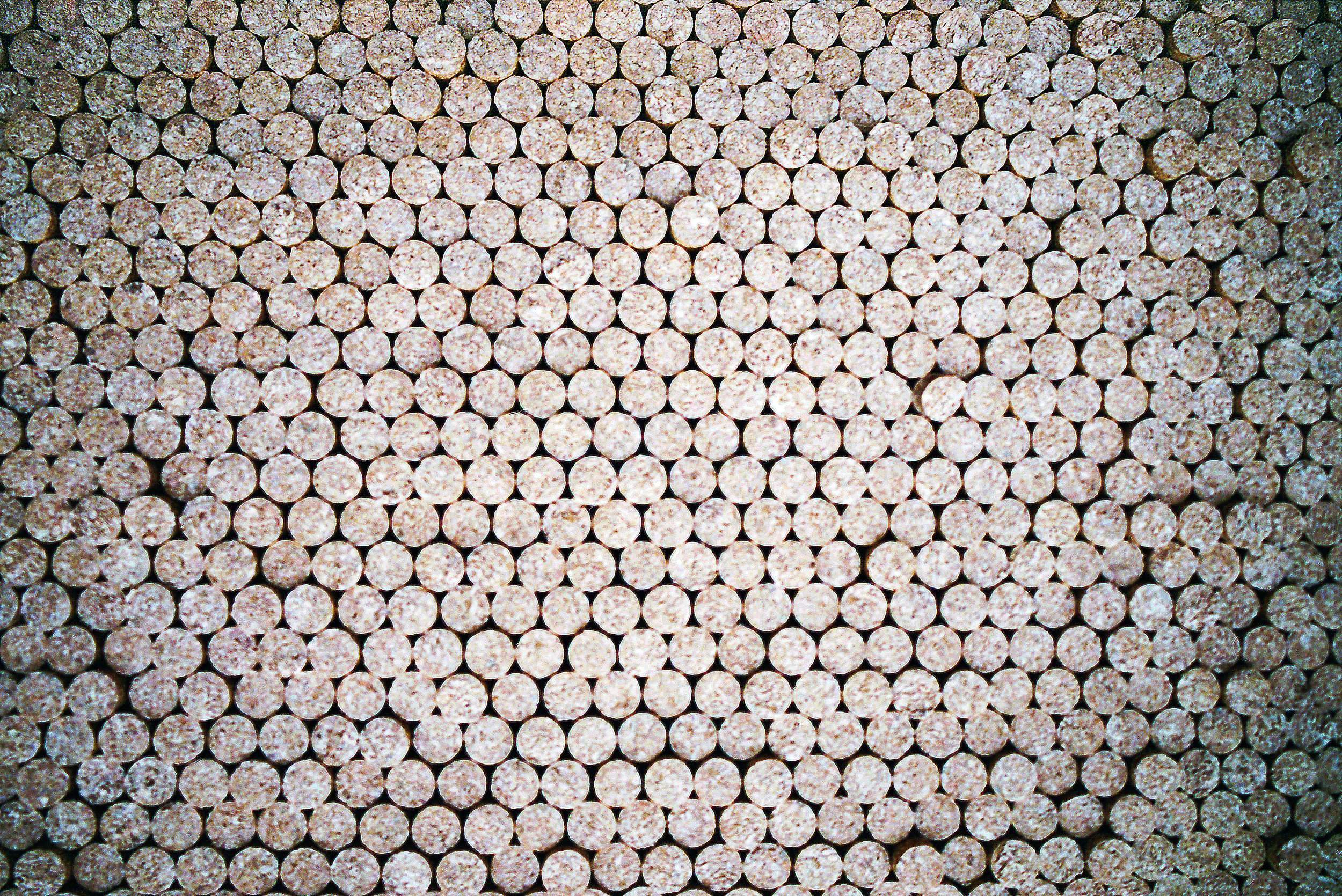 Billions of cork stoppers are produced each year—and making sure that they are not tainted is an important goal of cork sellers. After the cutting process in the fields the bark is transported to nearby factories. The process of transforming the bark into cork for spirits is a technically challenging one that employs many workers in the region. Each piece of bark is tagged and then analyzed to make sure that there are no impurities in the cork that would result in tainted wine.