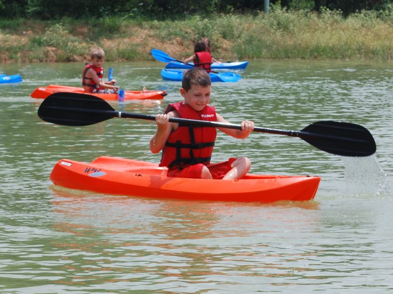 Campers learn to Kayak in our pond.