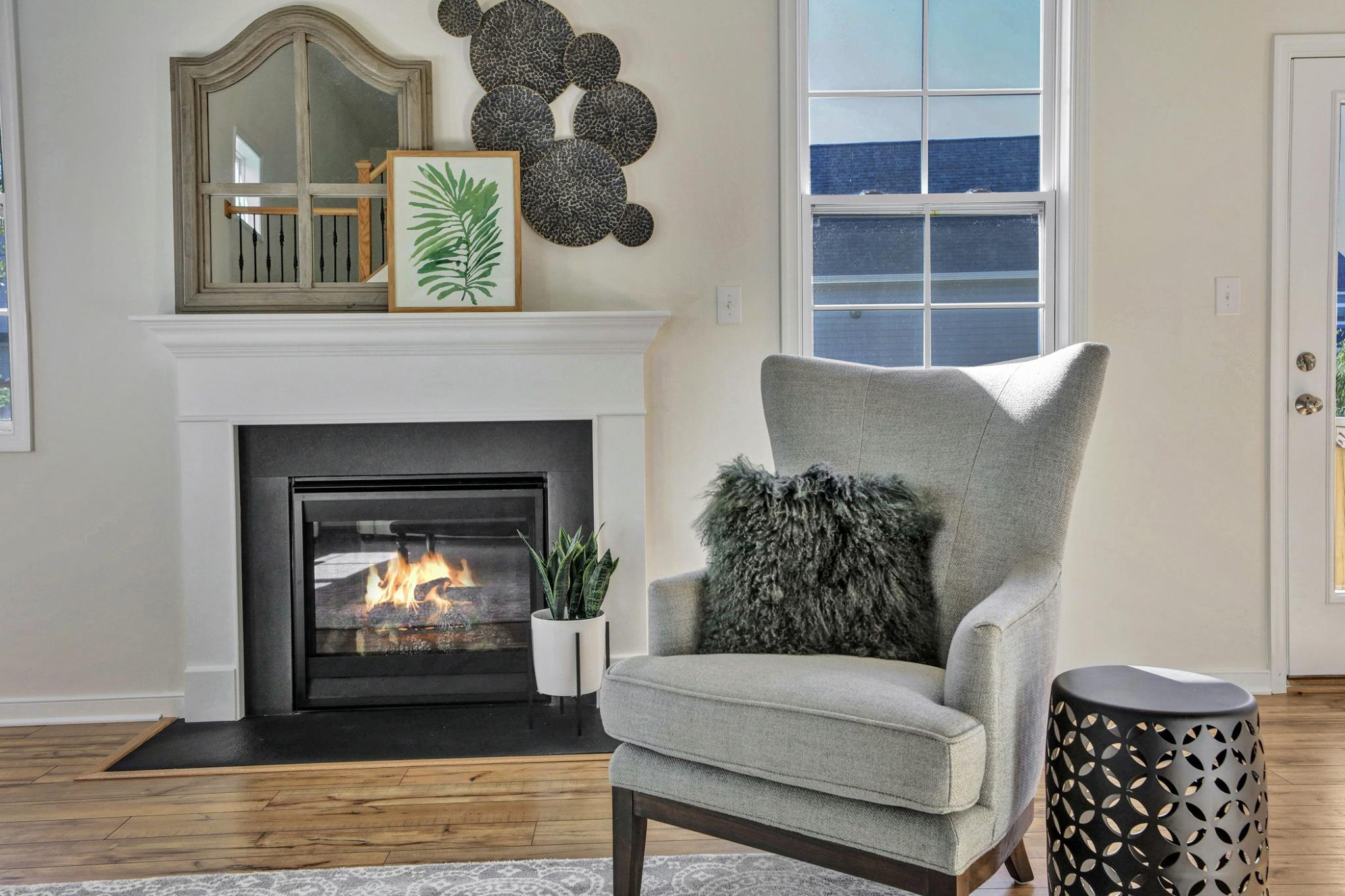 This fireplace showed off its softer side when plants were added to the decor.