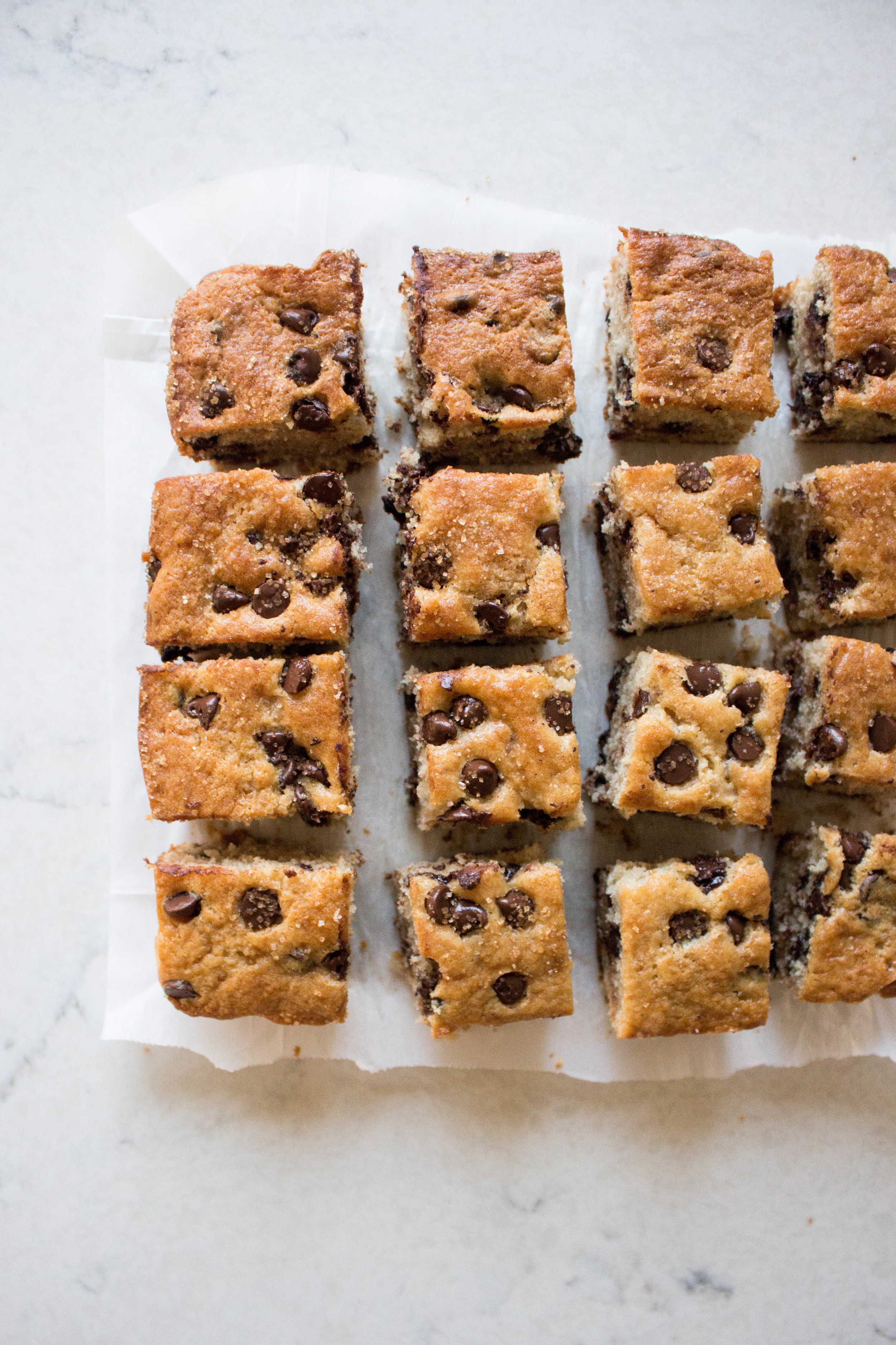 chocolate chip snack cake - makes one 8x8-inch panadapted slightly from The Sweet and Simple Kitchen1/2 cup butter, softened1/2 cup granulated sugar1/2 cup brown sugar2 eggs1 1/2 teaspoons vanilla1 1/2 cups all-purpose flour1/2 teaspoon baking soda2 teaspoon baking powder1/2 teaspoon cinnamon1/4 teaspoon salt1 cup sour cream or full-fat greek yogurt1 cup chocolate chipsraw turbinado sugar, for sprinkling (optional)