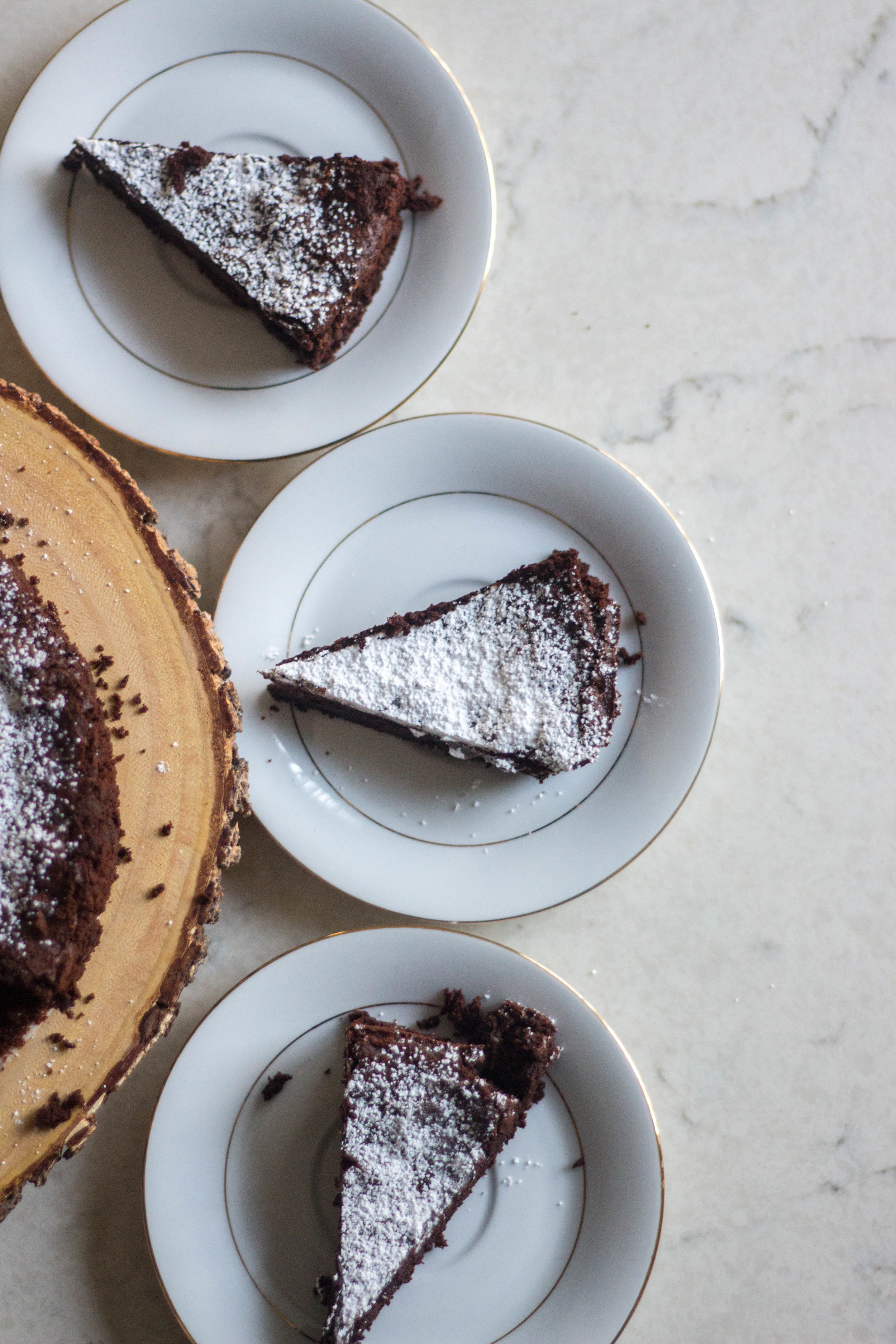 flourless chocolate cake - makes one 8- or 9-inch cakeadapted from king arthur flour1 cup semisweet chocolate chips1/2 cup unsalted butter3/4 cup granulated sugar1/4 teaspoon salt2 teaspoons espresso powder1 teaspoon vanilla extract3 large eggs1/2 cup dutch-processed unsweetened cocoa