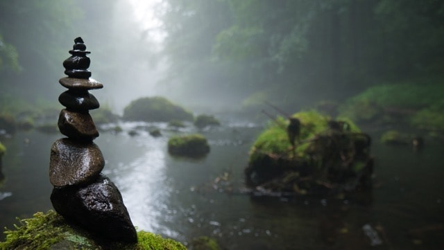 Zen stone pile on riverbank
