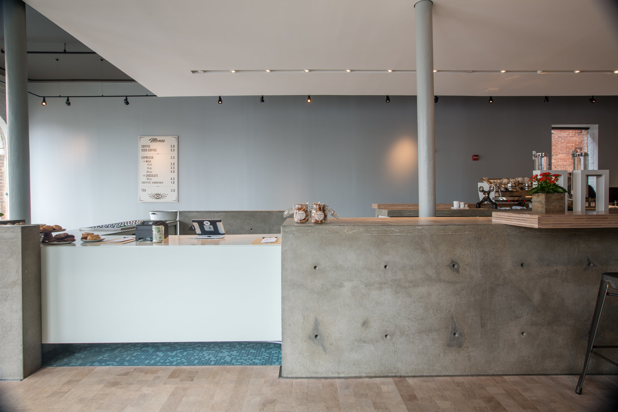 A custom design for a local coffee shop. They wanted something that showcased the material and utilized concrete in its truest form. For this project the floor need to be reinforced because we used traditional solid poured reinforced concrete in a new and unexpected application. The space was characterized by the juxtaposition of materials and textures.