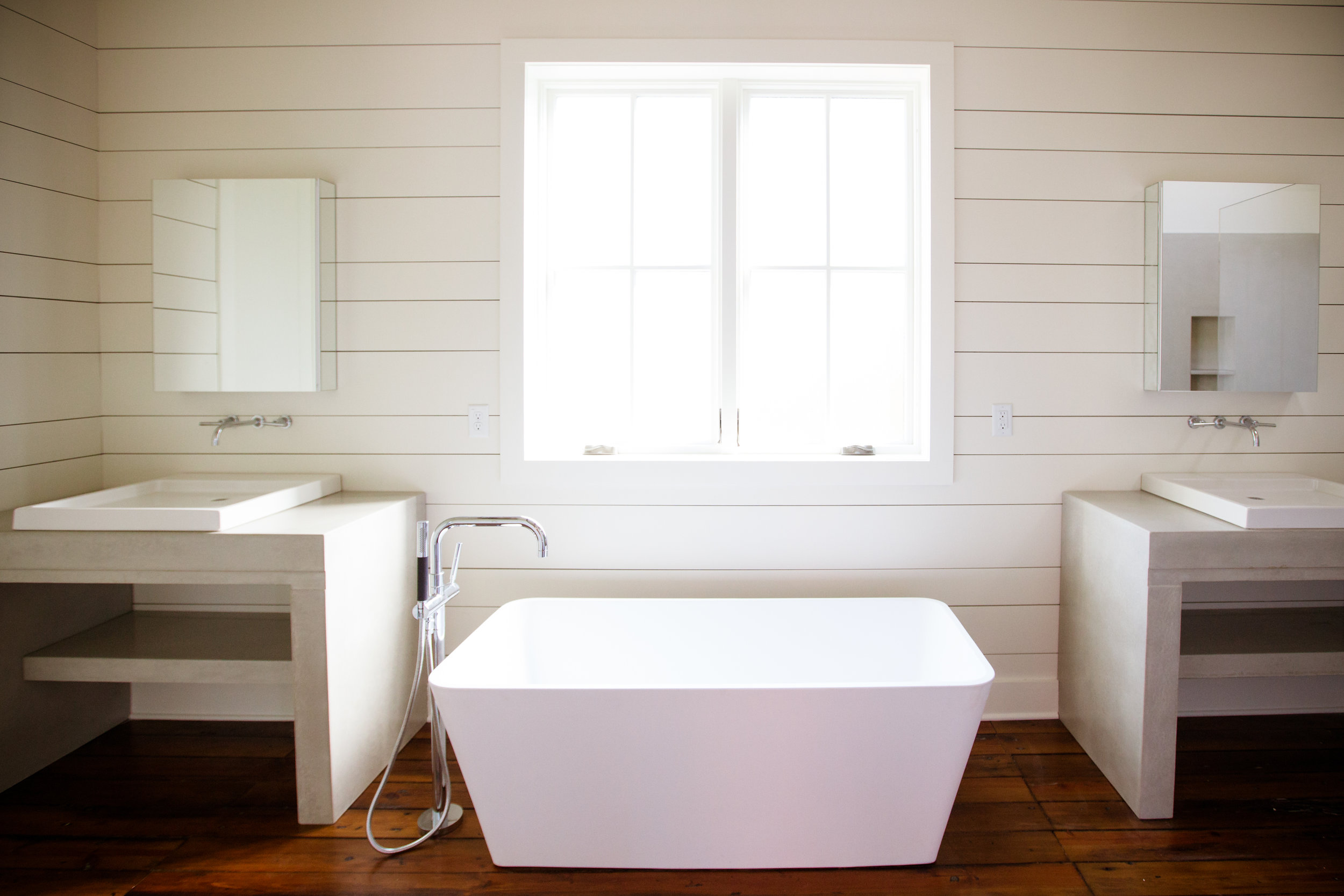 Twin cast vanities to round out this modern farmhouse bath.  #residential