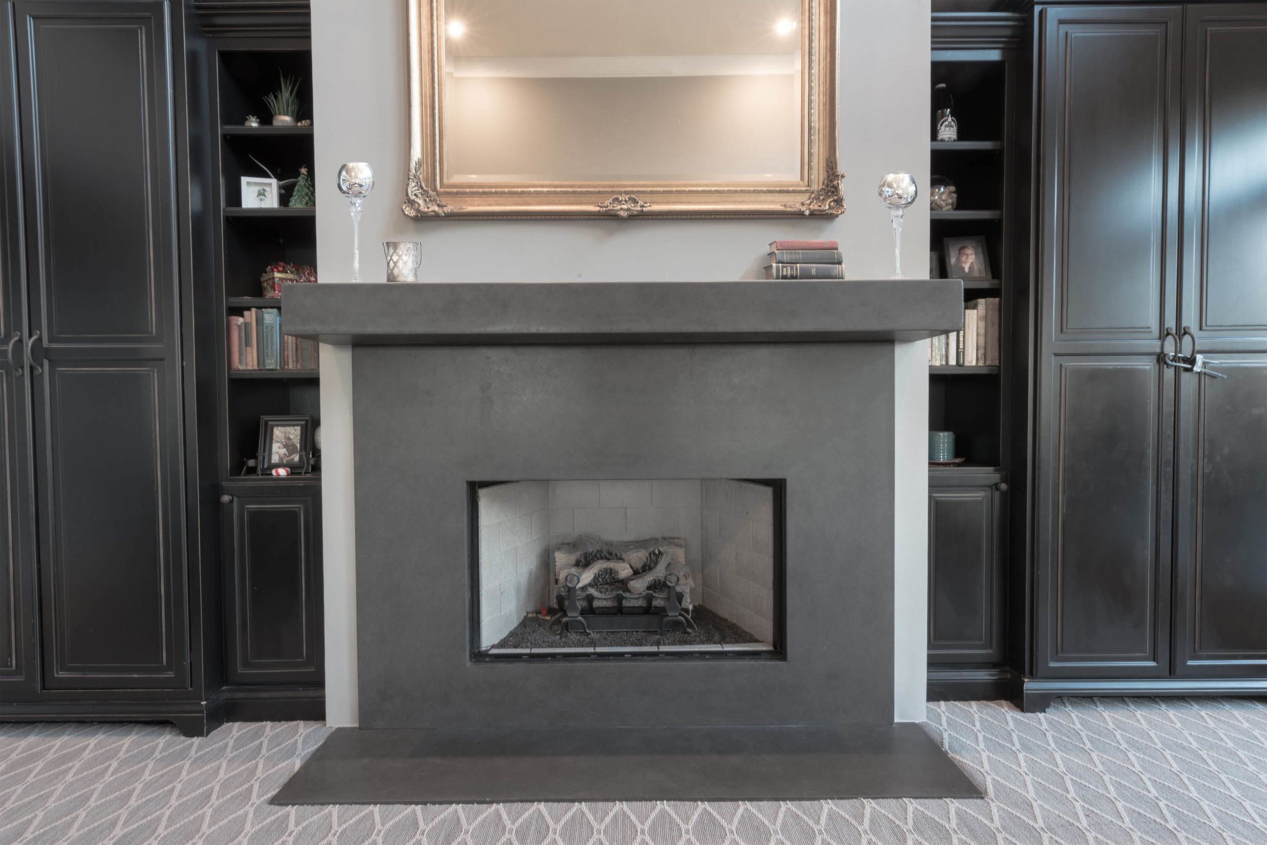 A clean fire surround and mantel quietly anchors the living space. Understated and solid.