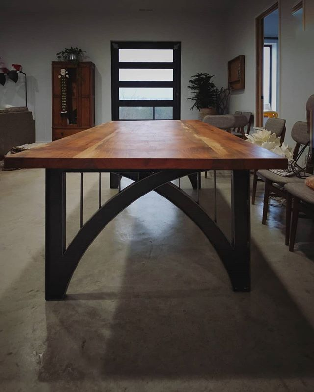 A custom dining table with a thick cherry wood top and a bridge inspired base. #furniture