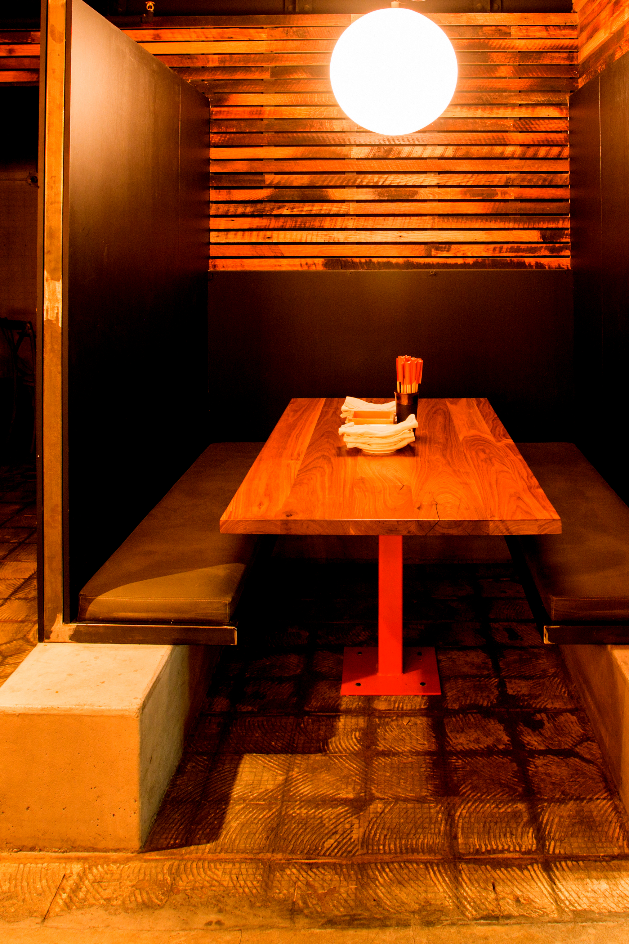 A restaurant project utilizing concrete, steel and wood to set an intimate and textured tone.