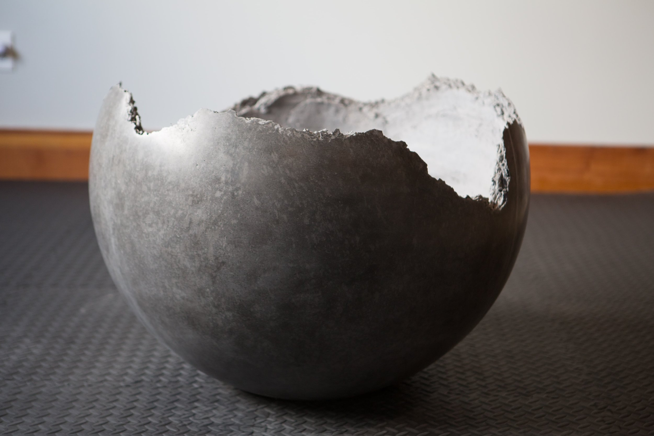 "This is a spherical planter with a ""live edge"" rim and a ""high-point"" finish. High-point finish is a varied speckled texture that gives the surface depth and interest.  #furniture"