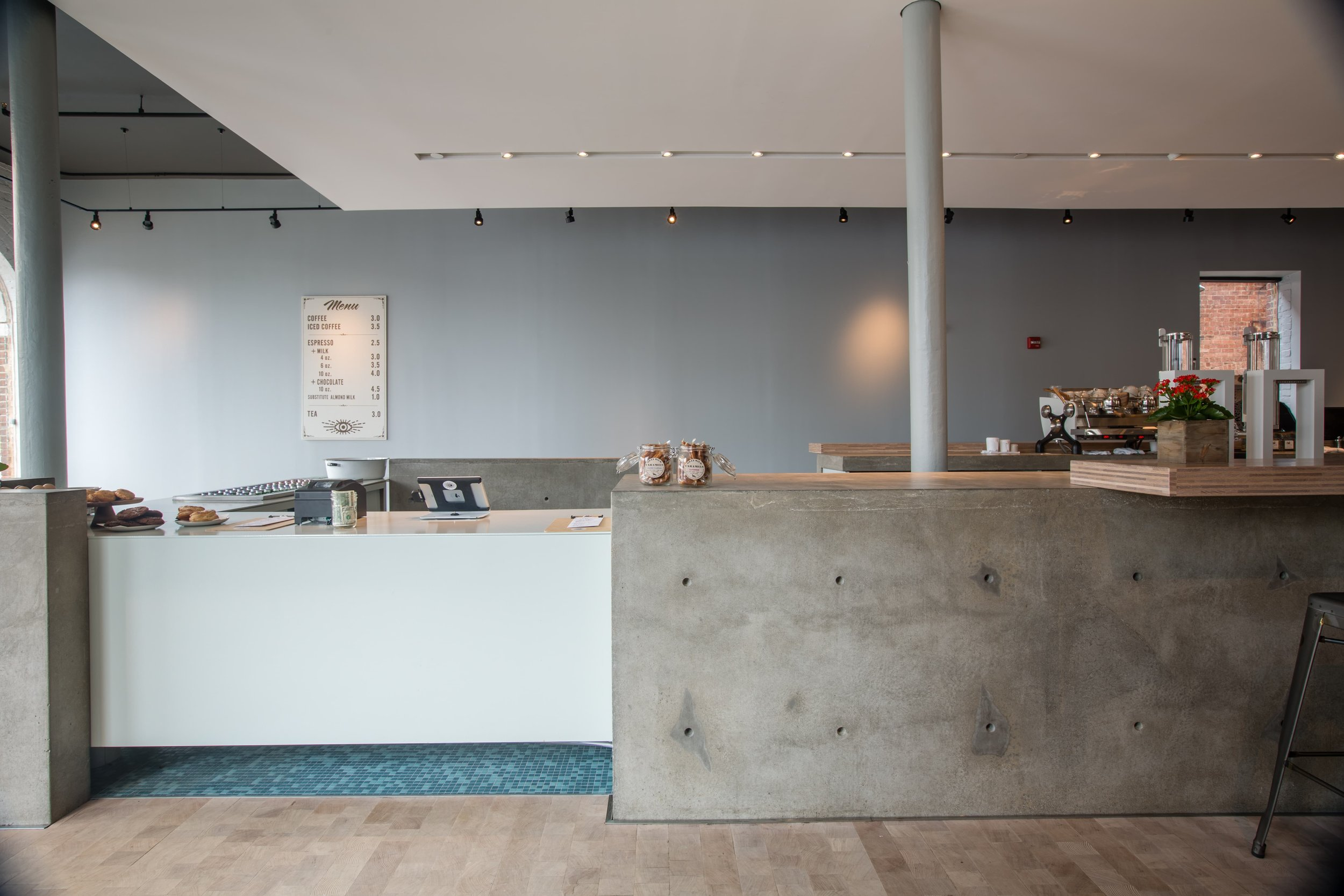 This was a massive project for a local coffee shop. There we wanting something true to the material used. All the concrete was old school formed with rebar reinforcement and wet cast with industrial concrete. The counters were so heavy the floors had to be reinforced before casting.  #commercial