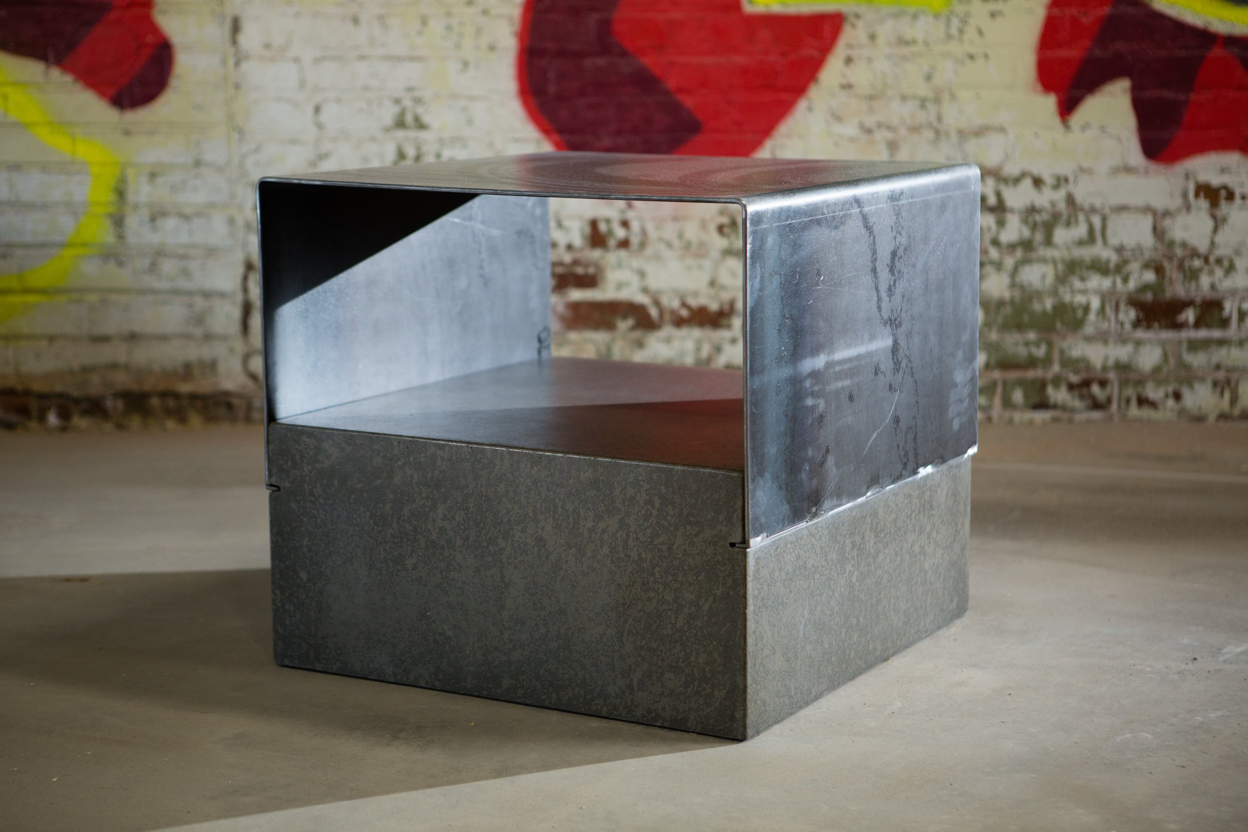 This is our  Wallace Side Table . The Wallace is a hollow cast concrete base with a waxed steel top. It is available on our store in a variety of concrete finishes.  #furniture