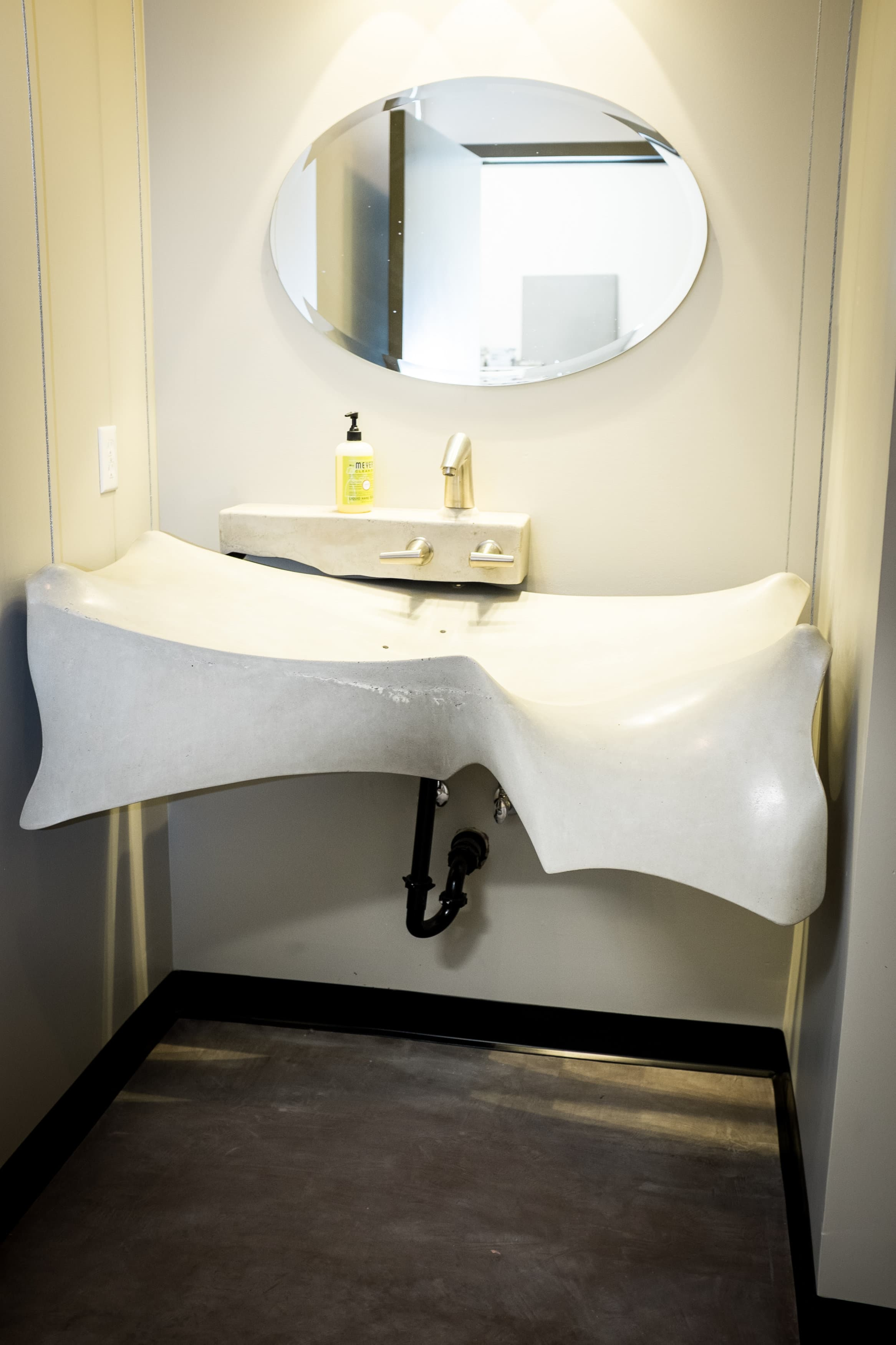 This is a custom sink that was made using a method called fabric forming. Fabric forms allow us to achieve beautiful flowing contours and points of tension. This particular sink pushed the limits of this technique; achieving thin fins and subtle drainage. Another unique feature is that it is suspended by cables from the ceiling; presenting unique plumbing challenges. #residential
