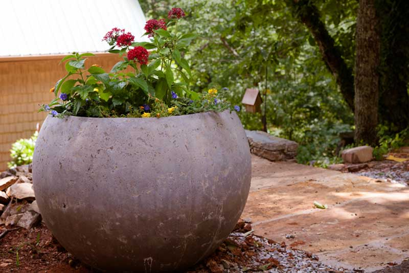A spherical planter at home in the garden. These are available in our store   here  .  #residential
