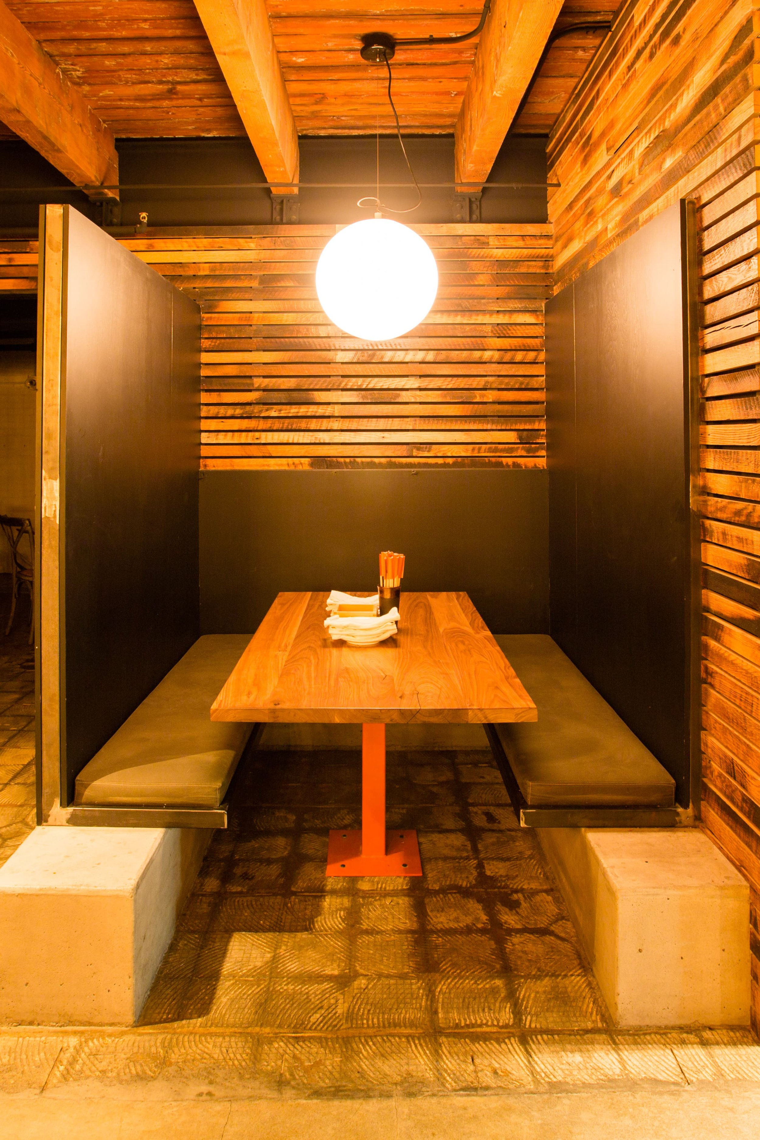 This is a local Izakaya and Ramen House. This was a great project because we were able to utilize waxed steel and concrete in a variety of ways. This is a beautiful space that leverages the individual nature of the materials to great affect. The booths used concrete bases and welded steel seating with extended backs. #commercial