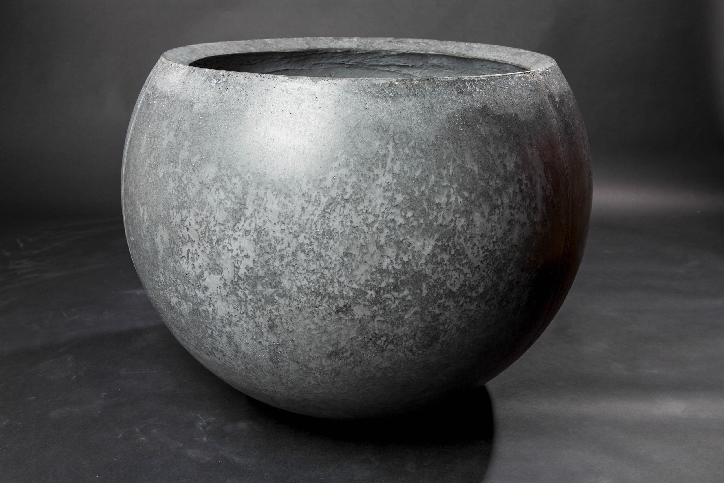 "This is our standard sphere planter in the color ""blackwater"". There are more finish options on our store."