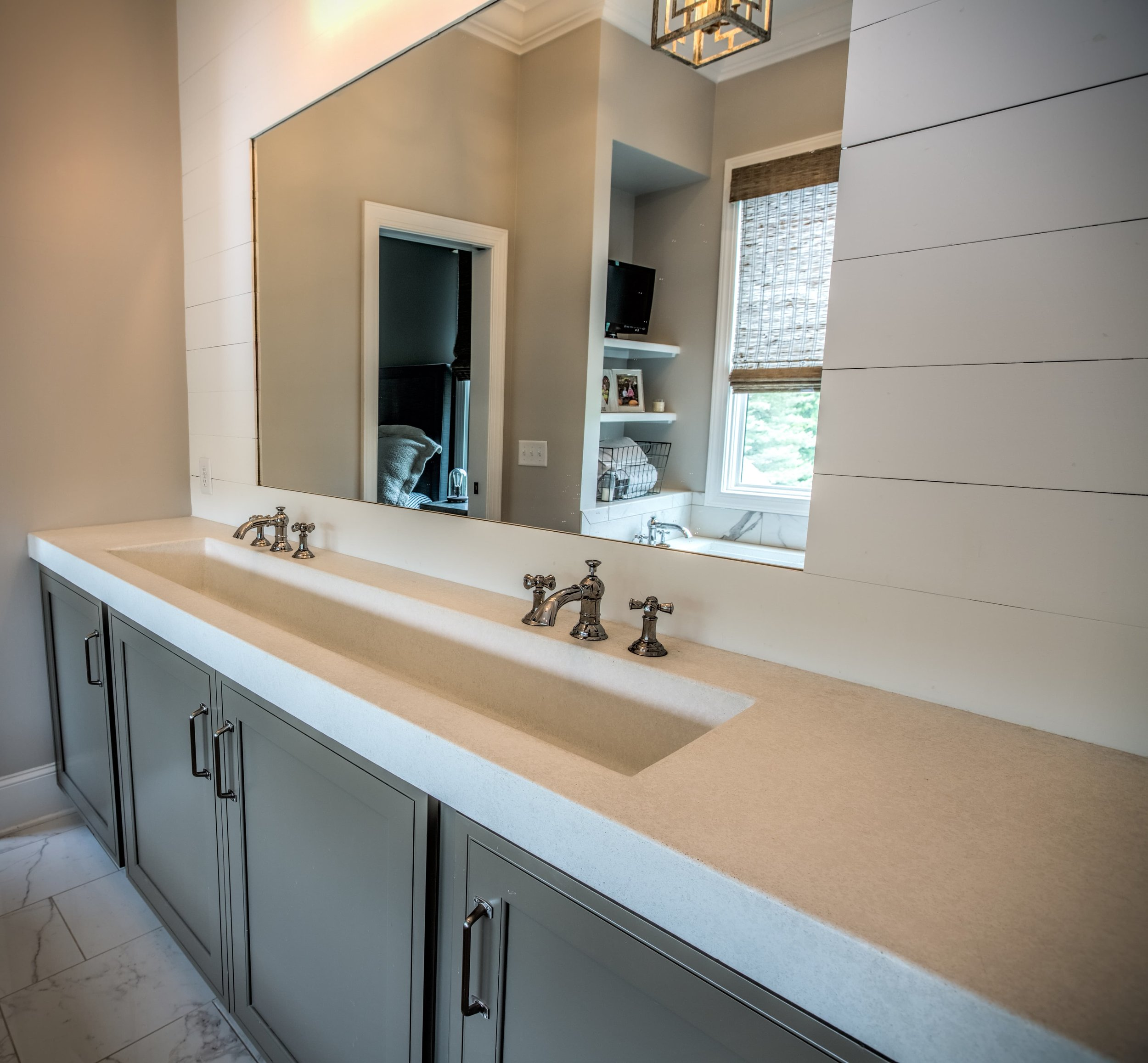 A single large integrated sink basin is a nice clean touch to this double vanity. #residential