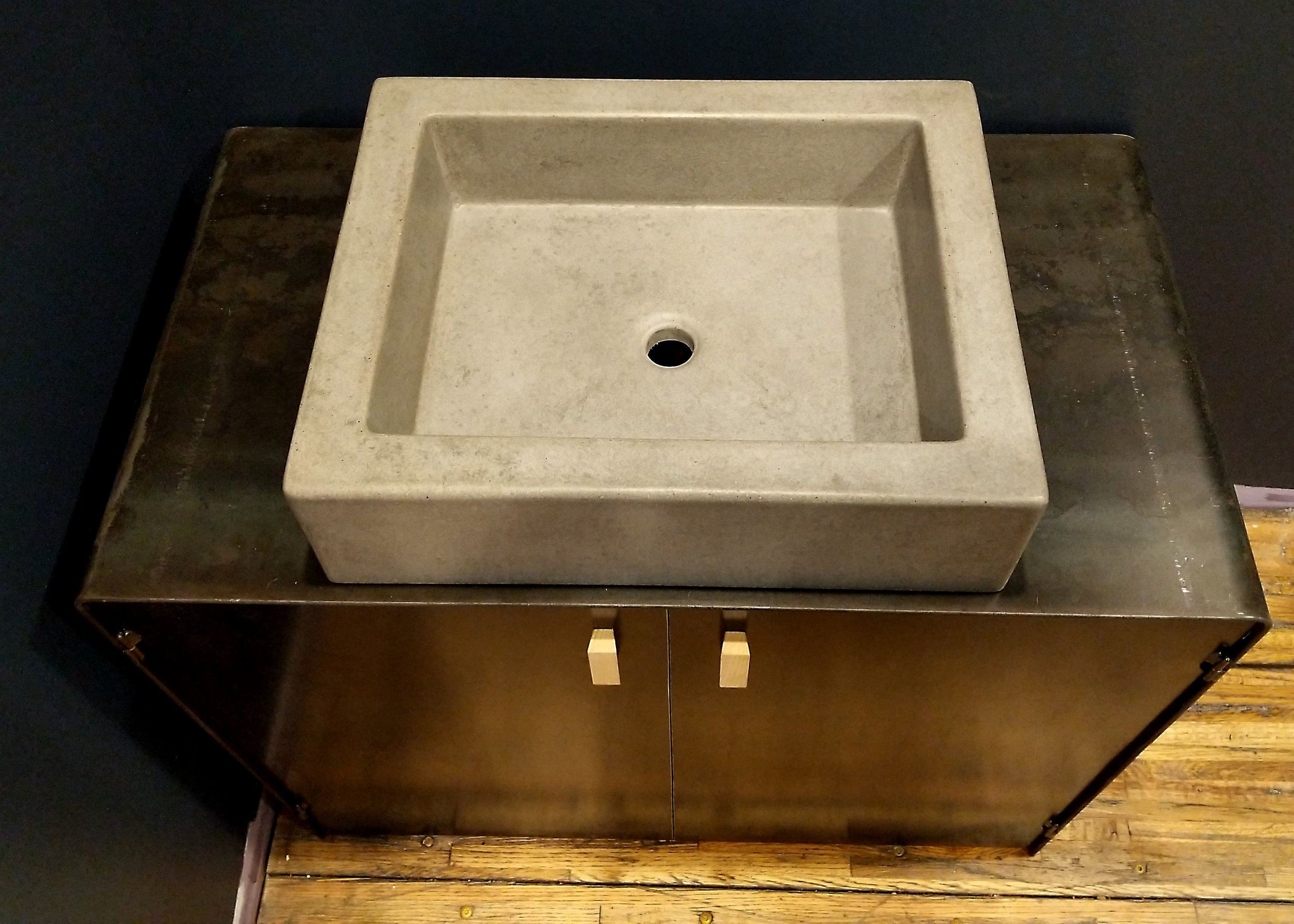 A custom all steel vanity with concrete basin sink for a powder room. #residential