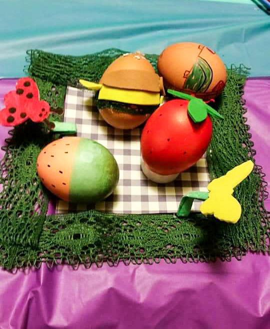 Our egg-cellent picnic! Front-back: watermelon, strawberry, cheeseburger, picnic basket.
