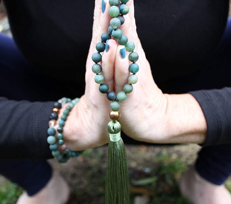 """Our """"I Am Abundant"""" Mala made with 8mm Matte Moss Agate, Copper Hematite, and two lava beads at the top for Essential Oil use."""