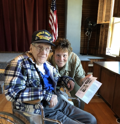 Bernard Adams and Granddaughter Prudy with the family's window dedication booklet.