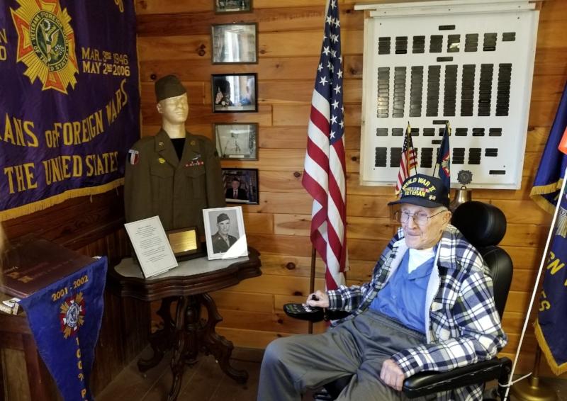 Bernard Adams at the Veterans exhibit, and his WWII uniform on display.