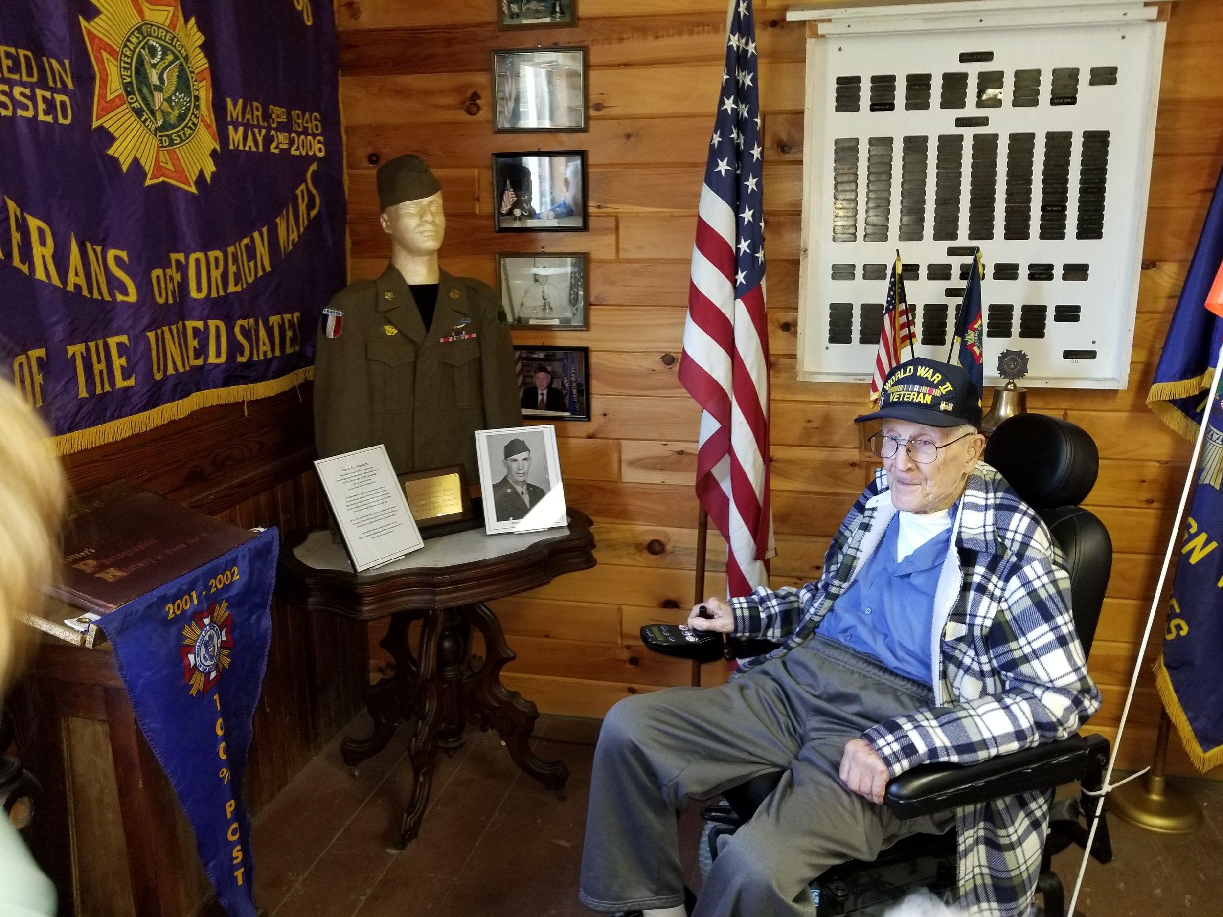 WWII Veteran Bernard Adams visits his exhibit in the museum room.