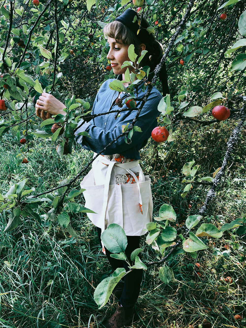 Standing in the apple orchard