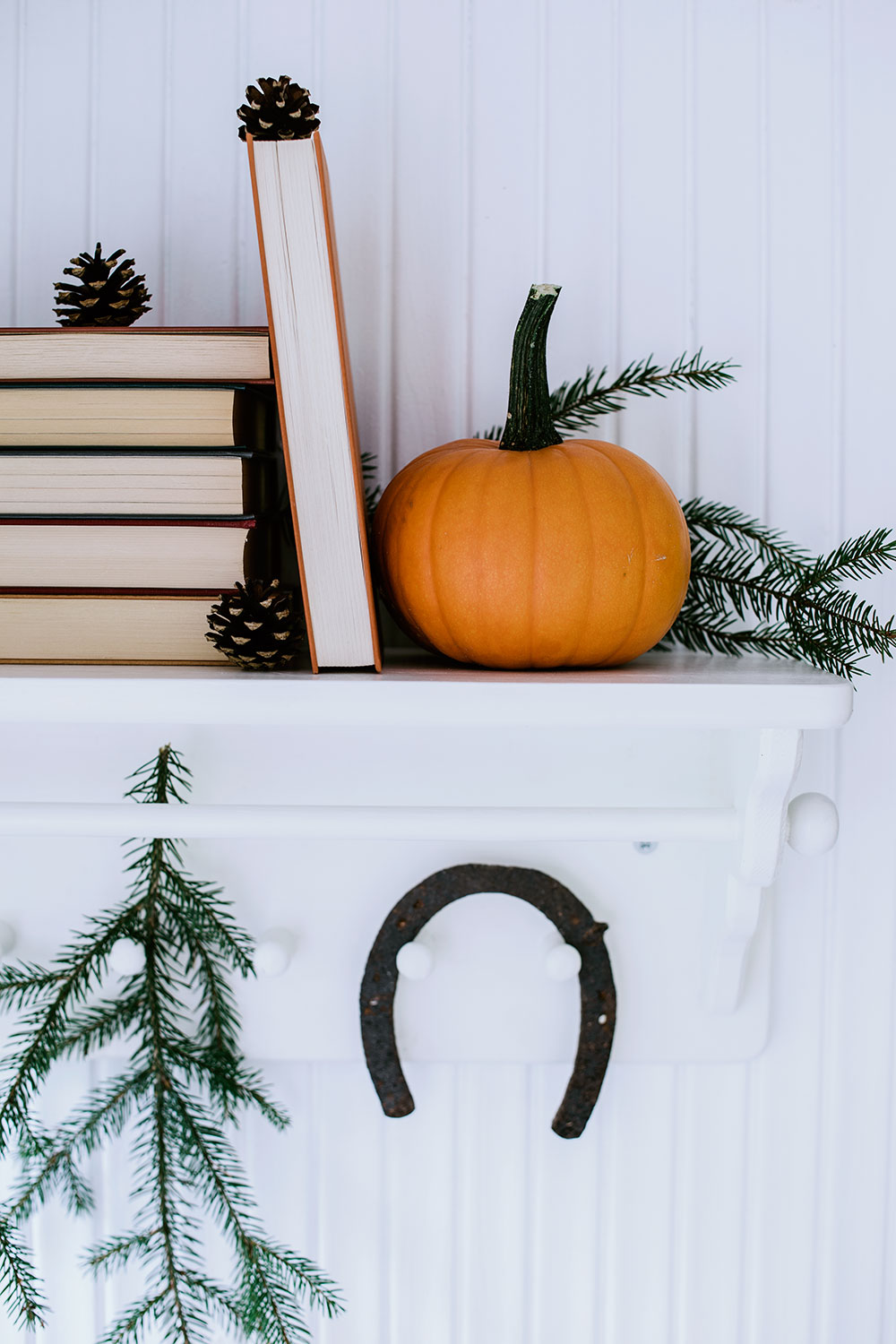Pumpkins and books in the entry