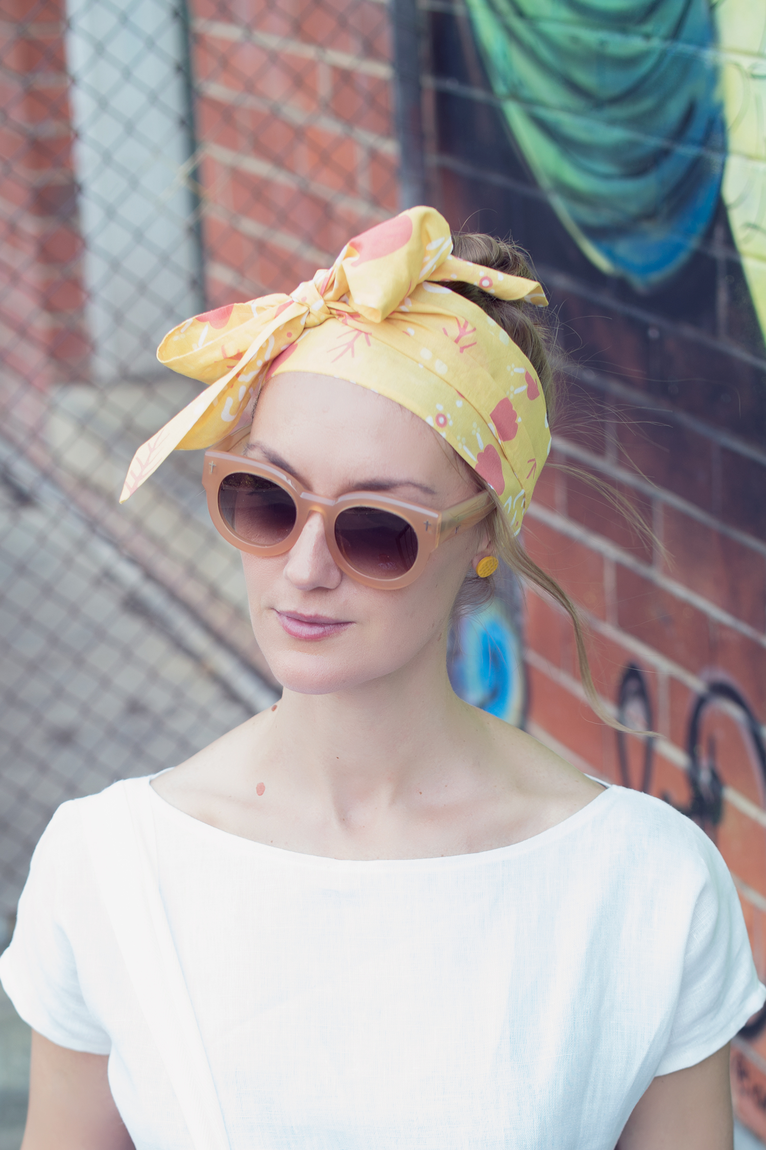 KESÄ HEADSCARF - YELLOW - Handmade from fine cotton voile that holds shape, our Kesä Headscarf is a beautiful accessory that will brighten any outfit. Wear it with a monochrome or neutral palette to showcase the colour and pattern of the headscarf.