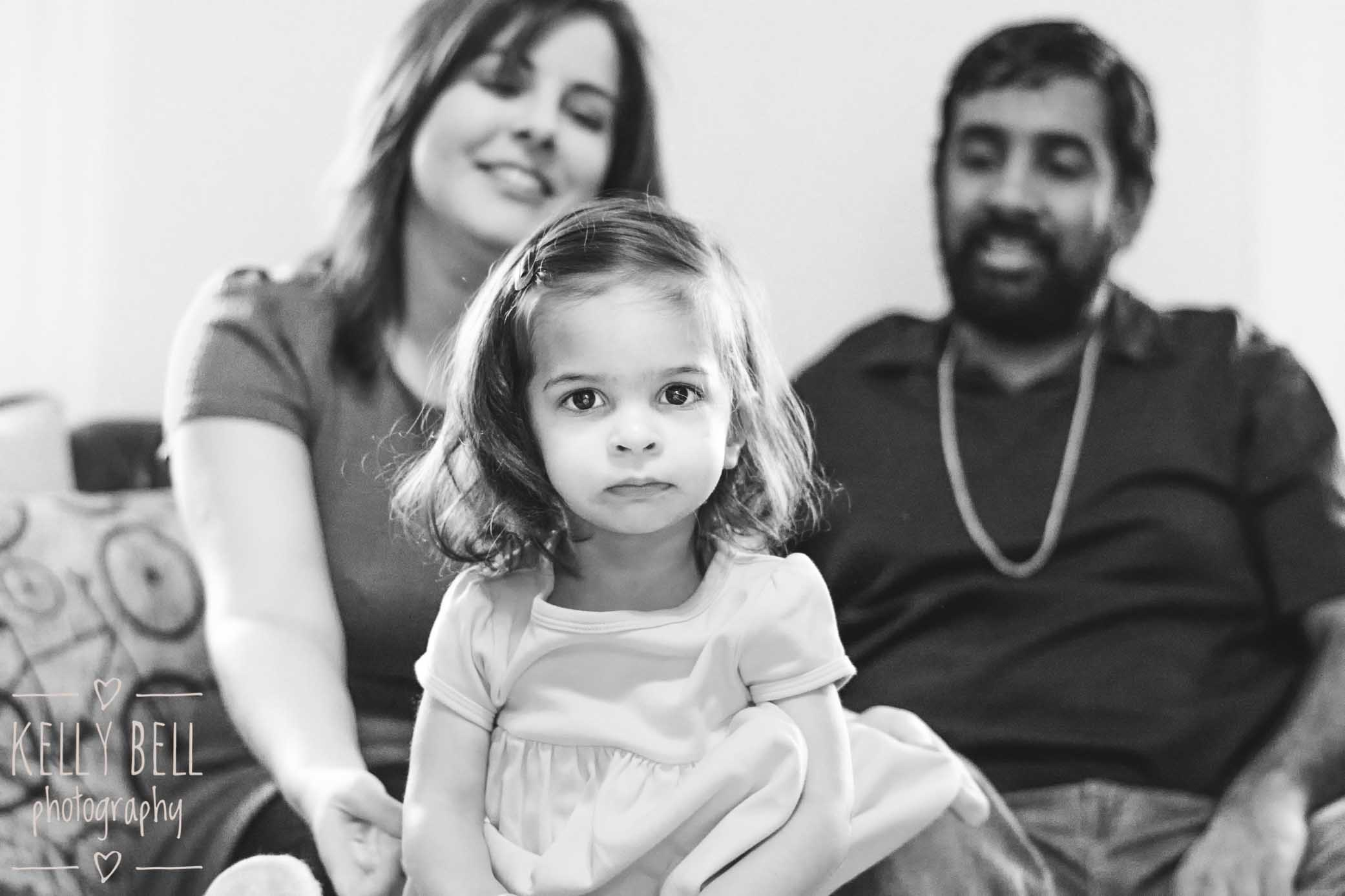 girl and parents from in-home family lifestyle mini photography session in brookland dc