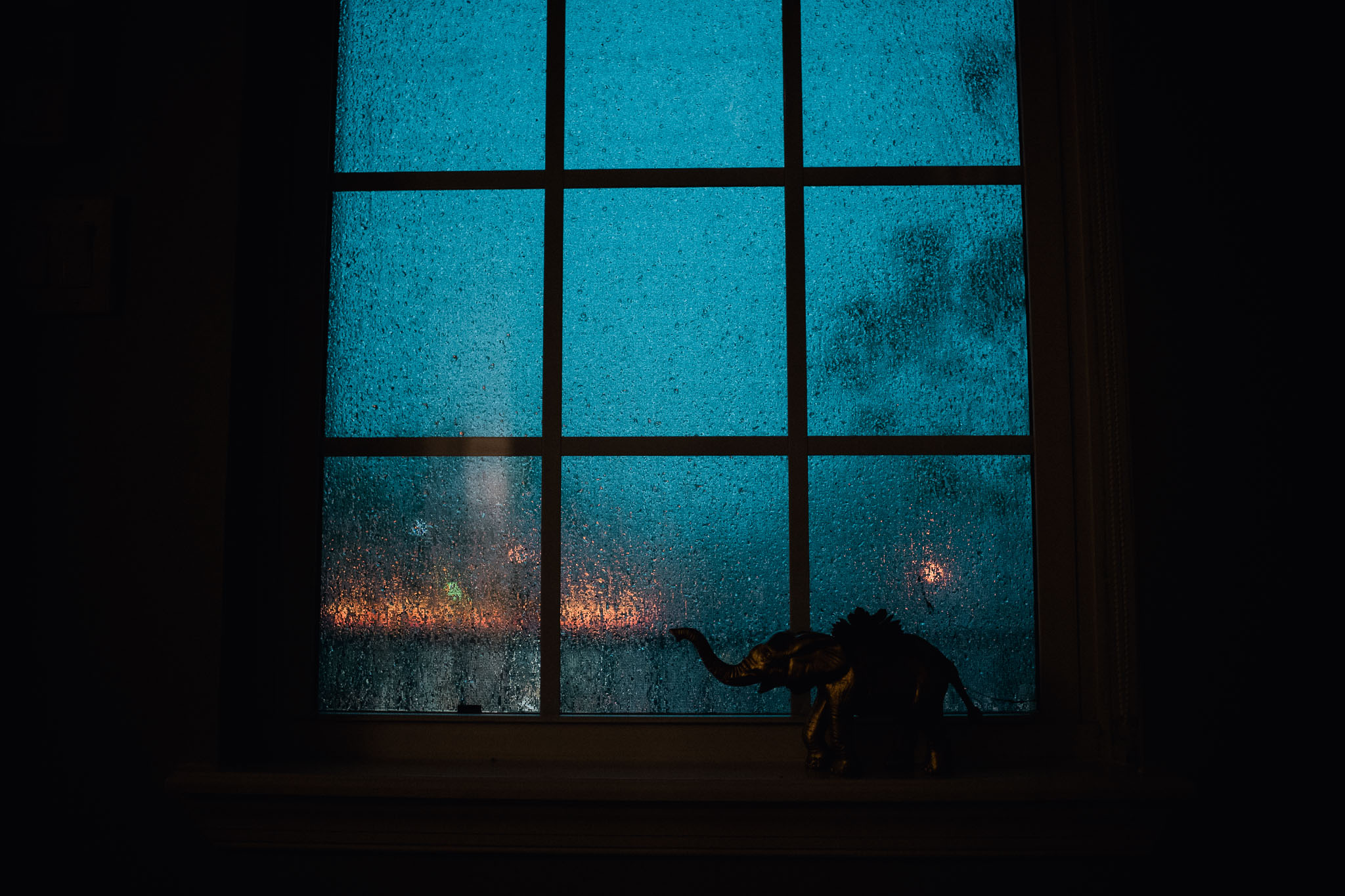 Day 1. A shot of the storm through our window. It's rare for me to take a picture without people in it but I love the mood and glow from the gas station in this shot.